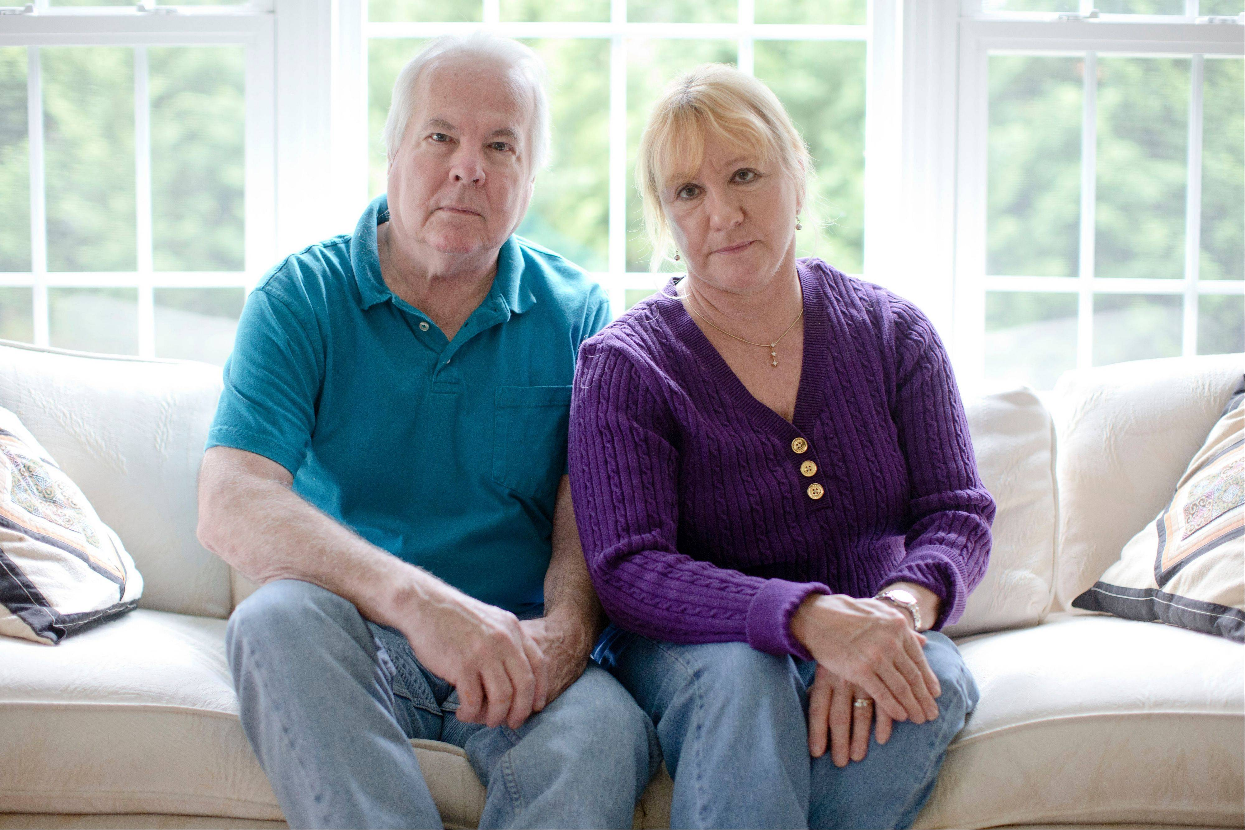 Dean and Mary Lou Griffin sit their home Friday in Chadds Ford, Pa.. The Griffins are among millions of people nationwide who buy individual insurance policies and are receiving notices that those policies are being discontinued.