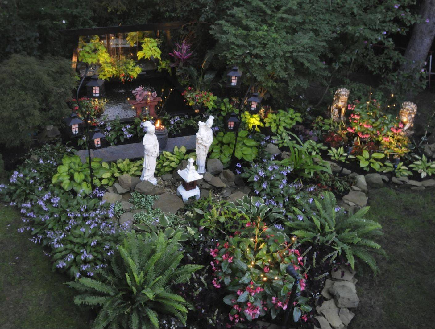 Lighting transforms the backyard of McHugh's garden into a magical place at night.