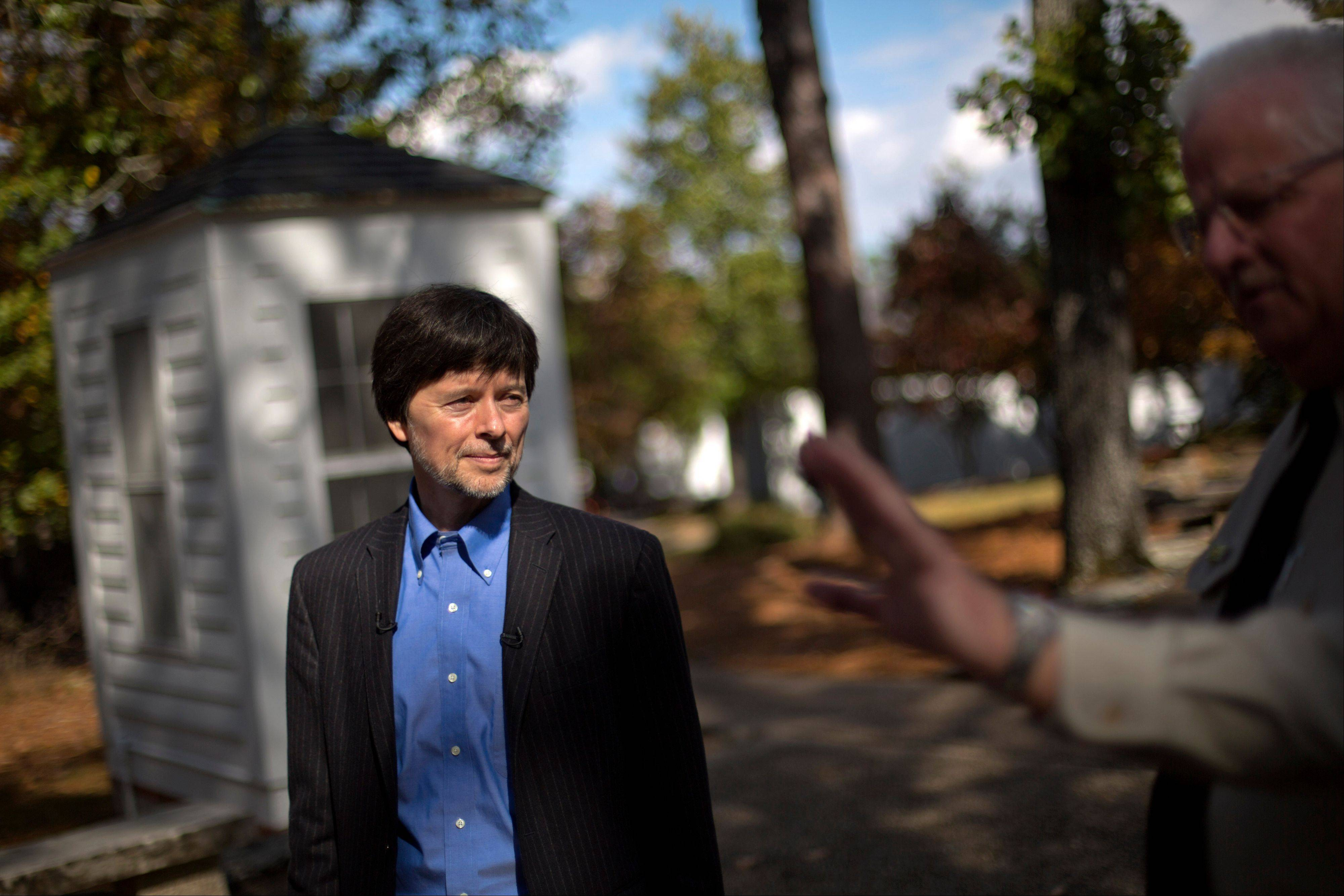 Documentary filmmaker Ken Burns walks through the entrance of the Georgia home used by former President Franklin D. Roosevelt during a tour by site manager Robin Glass, right, Saturday, in Warm Springs, Ga. Burns along with several members of the Roosevelt family toured the home known as the Little White House Saturday used by Roosevelt as Burns previewed parts of his 14-hour film on the Roosevelt's.