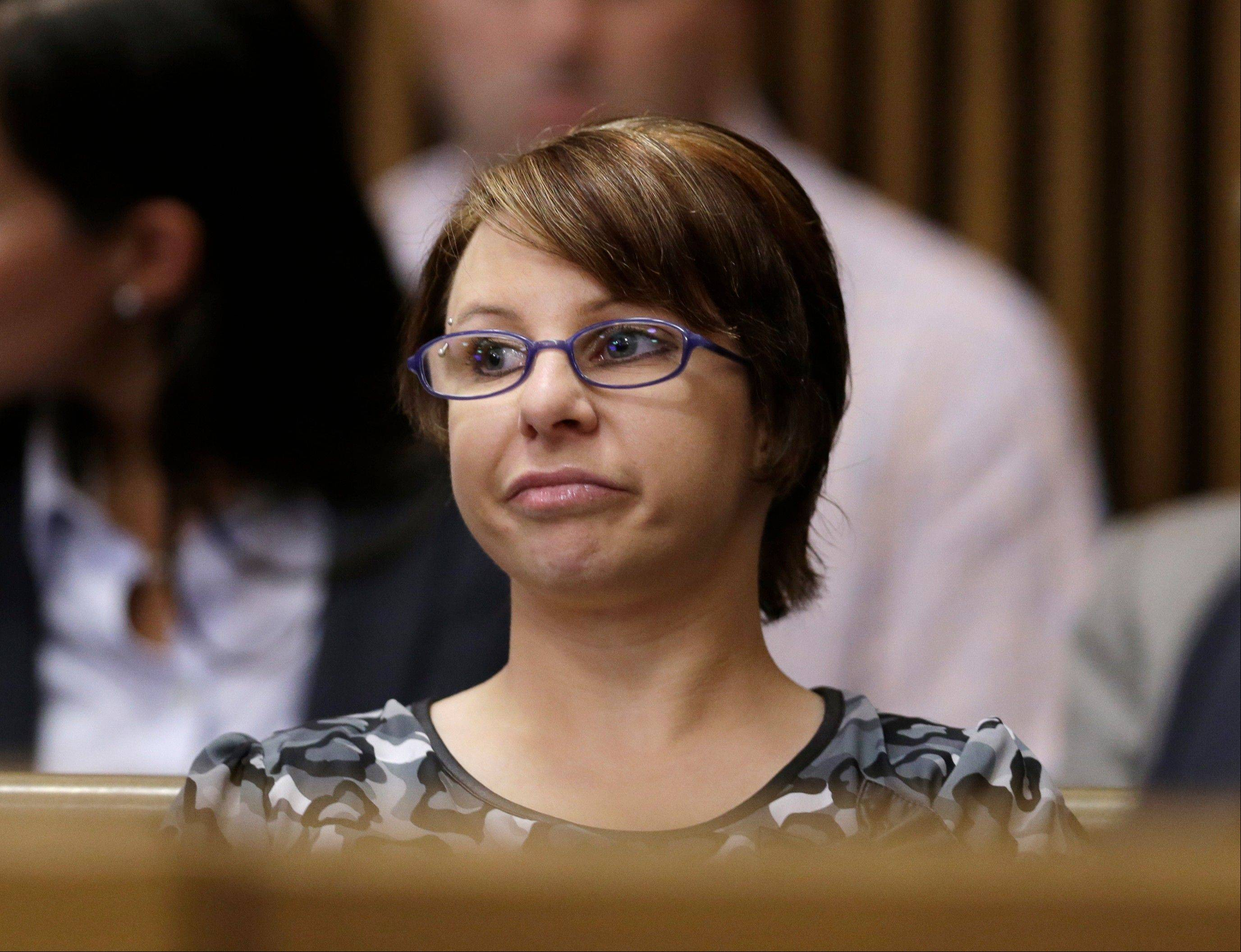 "Michelle Knight sits in the courtroom Aug. 1 during the sentencing phase for Ariel Castro in Cleveland. Knight, one of three women who escaped from a ramshackle Cleveland home after more than a decade in captivity, is scheduled to appear on the ""Dr. Phil"" TV talk show Tuesday."