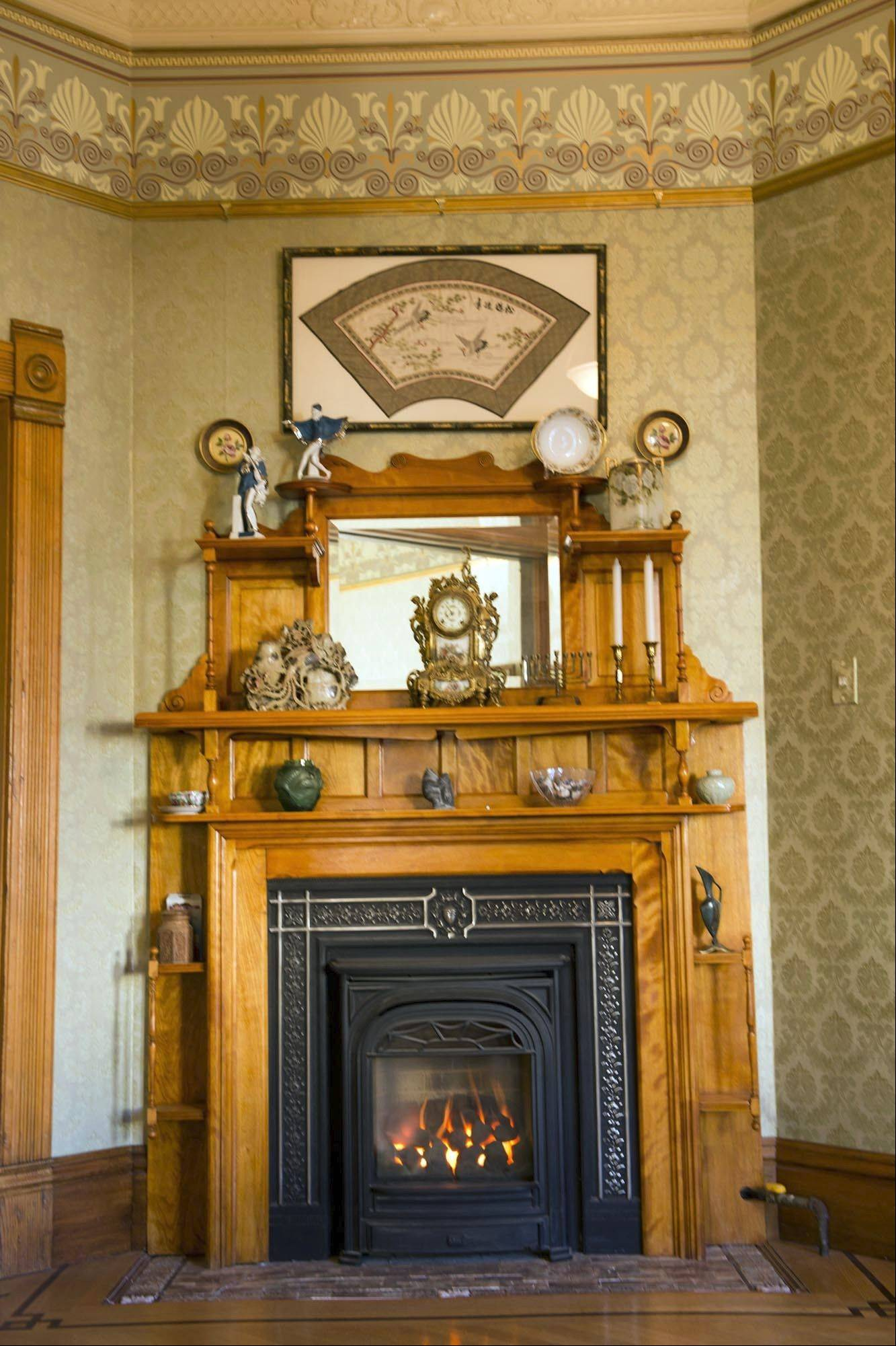 The original restored fireplace in the second parlor of Mehler's home.