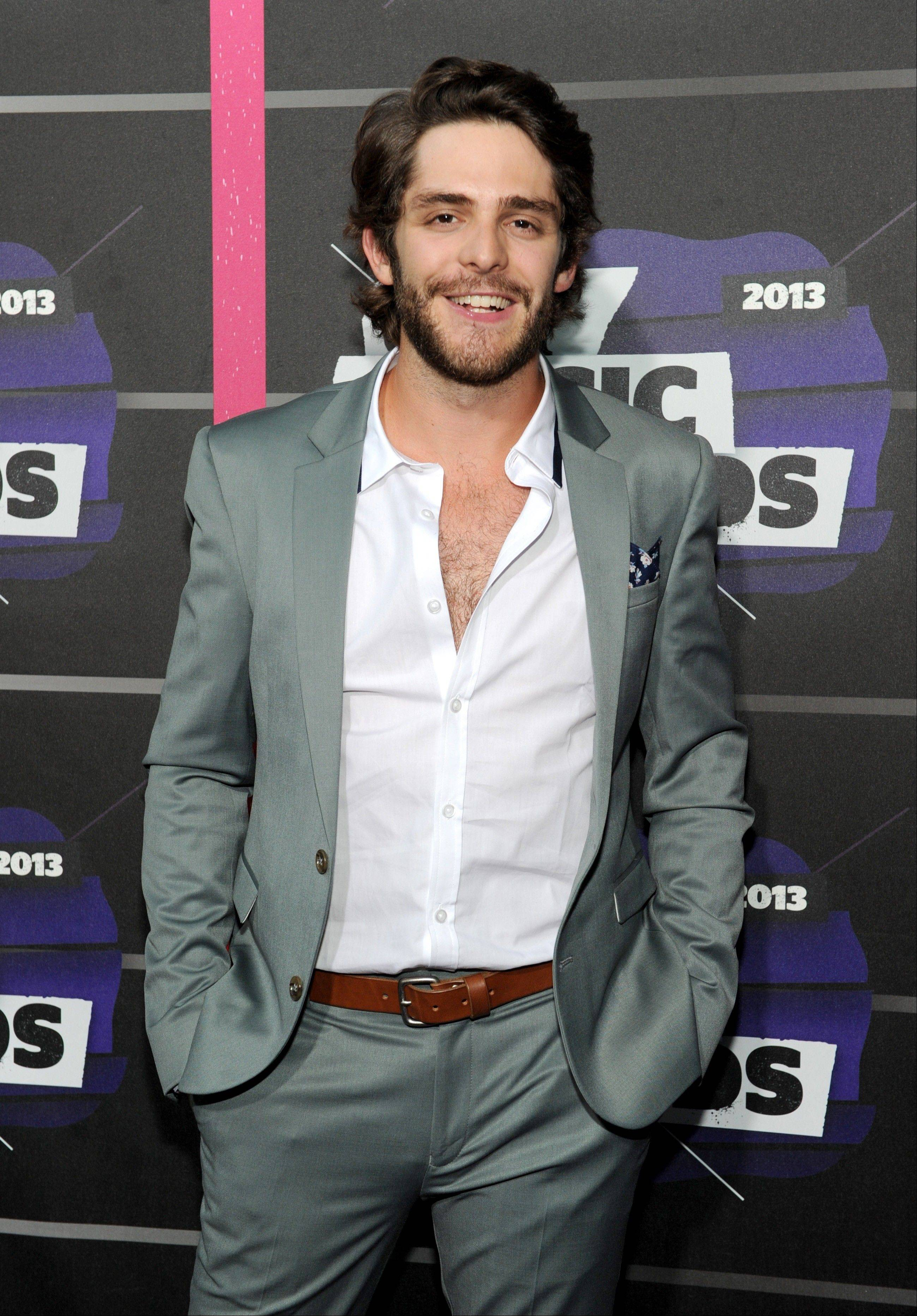 Thomas Rhett, whose full name is Thomas Rhett Akins Jr., grew up in the limelight of his father's success, even appearing on television and on stage singing songs with his dad, Rhett Akins. The father and son songwriters managed to get credits on five of the top 10 songs on country radio in early October 2013.