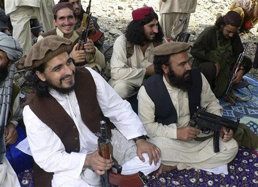 In this 2009 photo, new Pakistani Taliban chief Hakimullah Mehsud, left, is seen with his comrade Waliur Rehman, front center, during his meeting with media in Sararogha of Pakistani tribal area of South Waziristan along the Afghanistan border. Intelligence officials said Friday, Nov. 1, 2013 that the leader of the Pakistani Taliban Hakimullah Mehsud was one of three people killed in a U.S. drone strike.