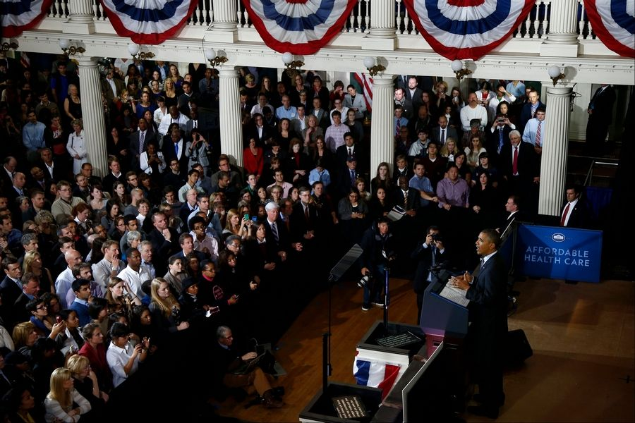President Barack Obama speaks Wednesday at Boston's historic Faneuil Hall about the federal health care law.