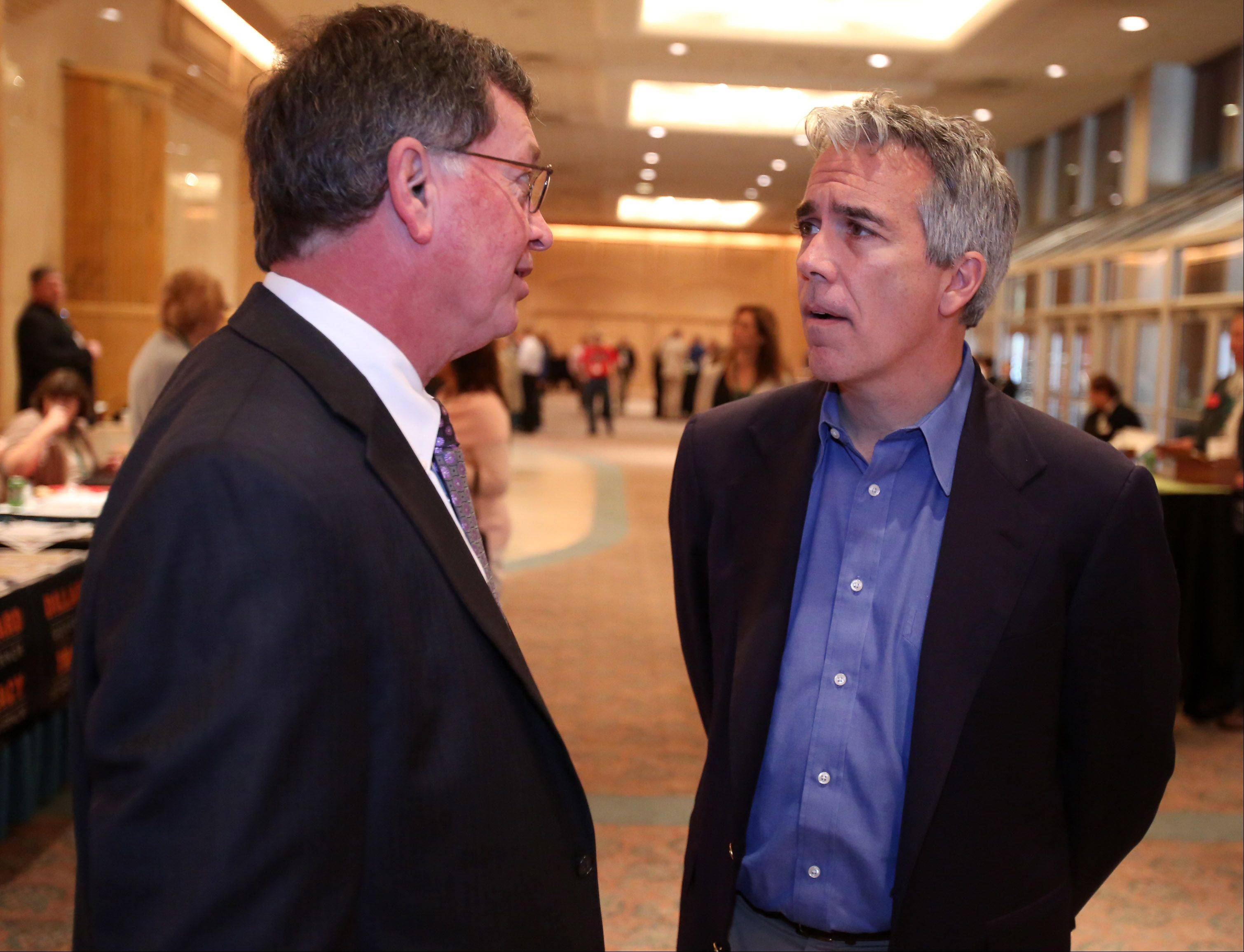 James Bassett, president at Bassett Management Services, left, speaks with conservative radio broadcaster Joe Walsh at the Restore Illinois Summit on Saturday at the Stephens Convention Center in Rosemont.