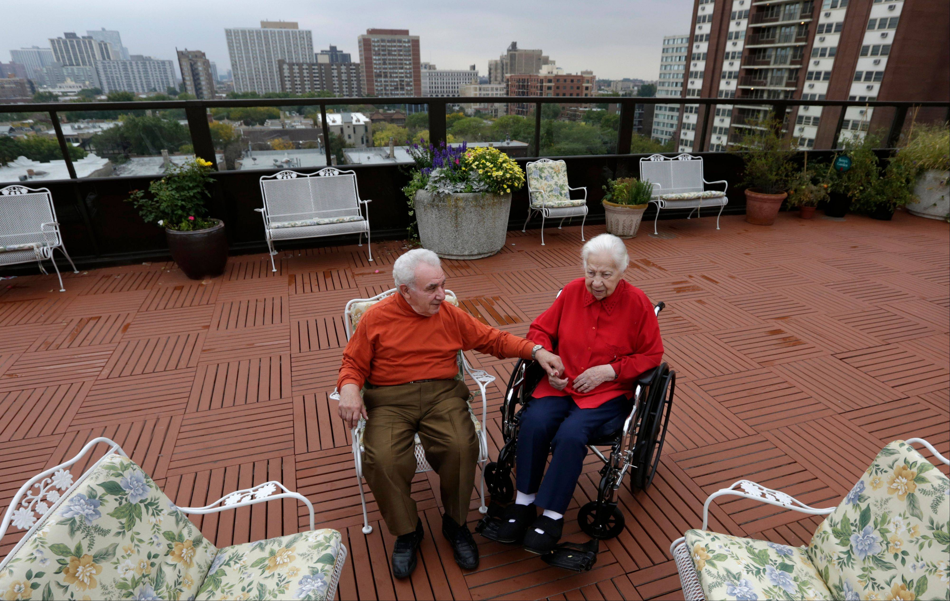Holocaust survivors, Joe Chaba, 85, and his wife, Helen, 89, sit together on the rooftop at the retirement community called Selfhelp Home, on the North Side of Chicago.