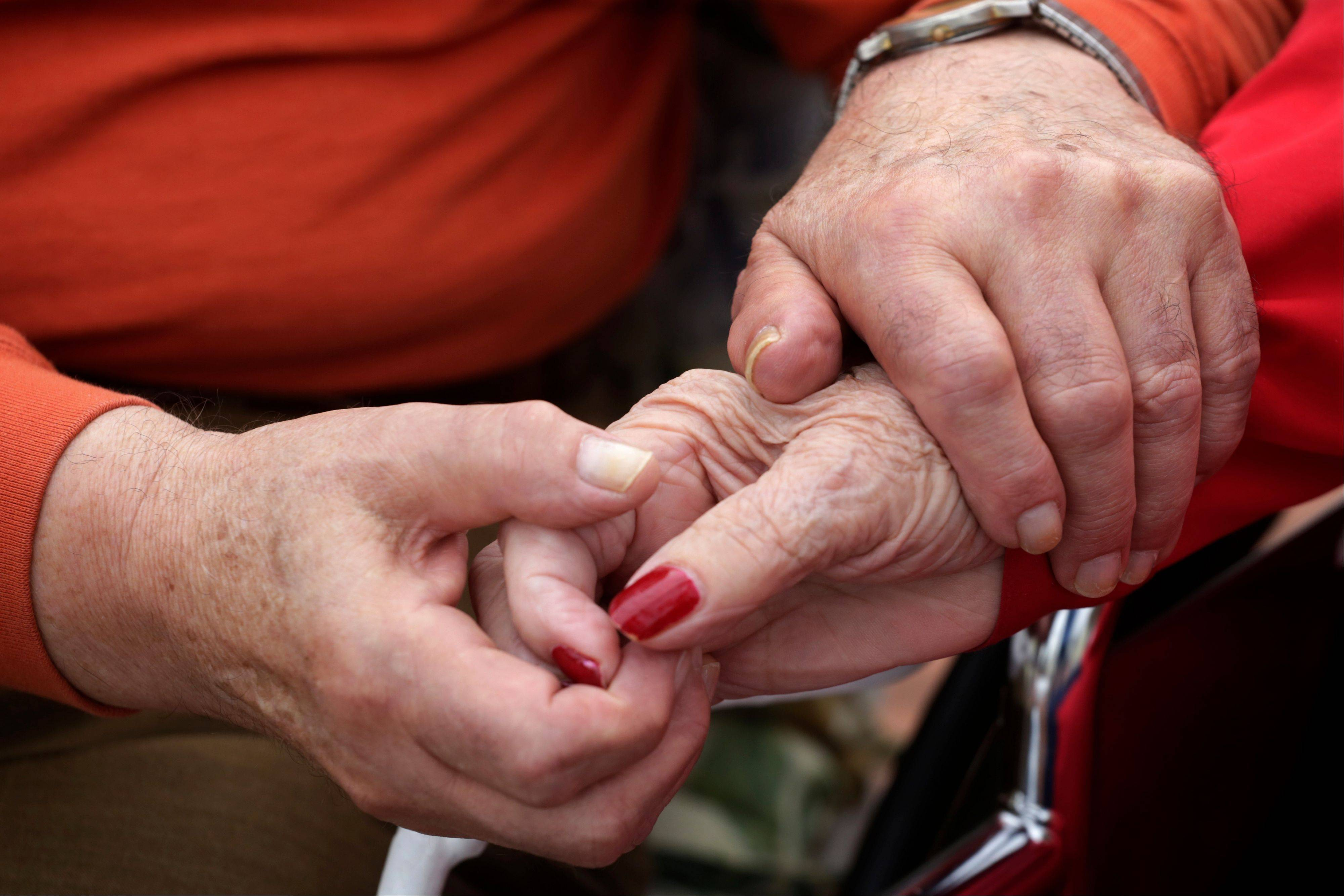 Holocaust survivor Joe Chaba holds hand with his wife, Helen.