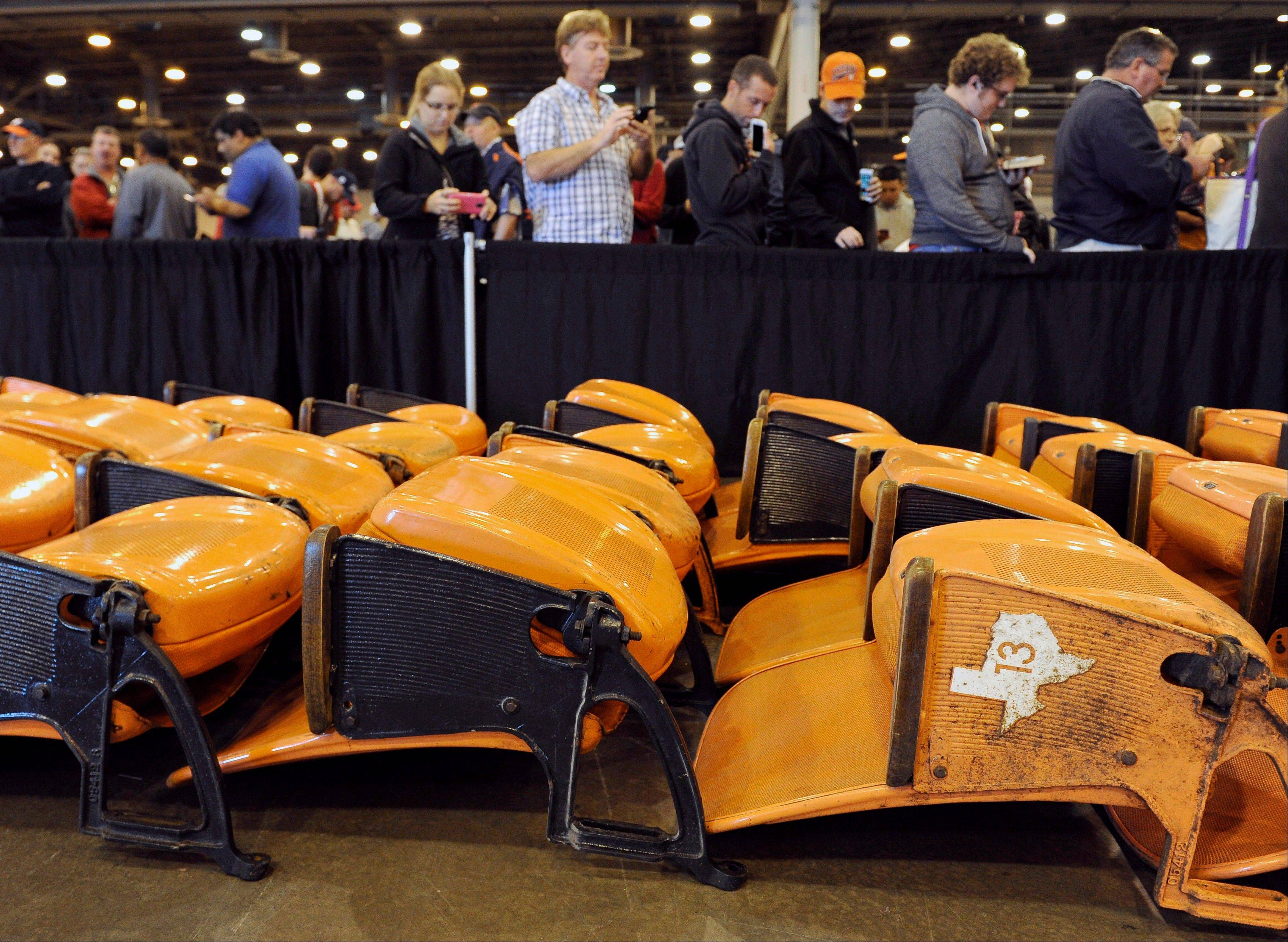 Associated Press/Pat Sullivan People line up to buy stadium seats.