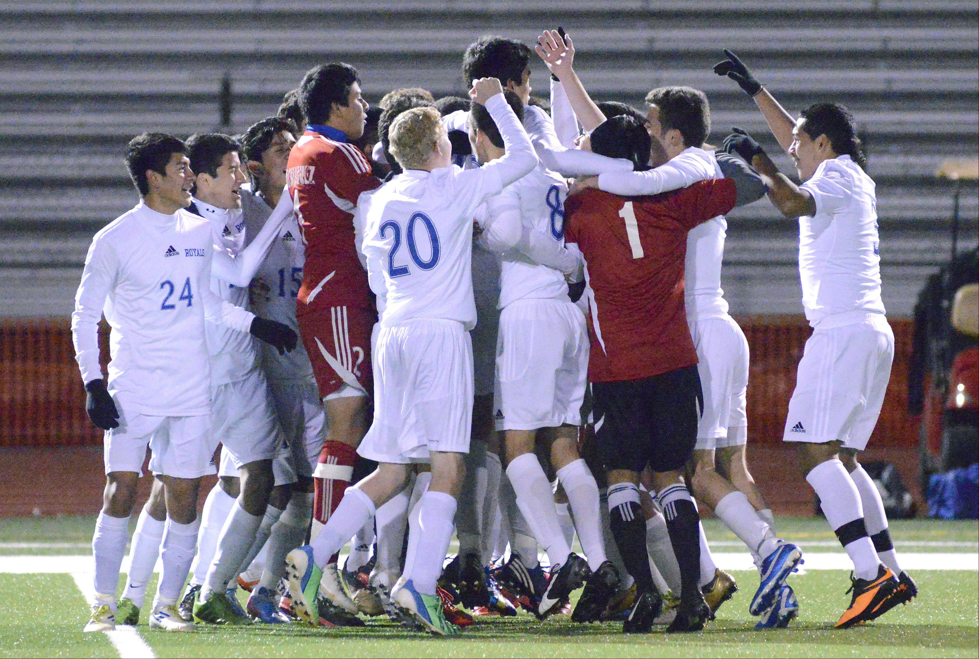 Larkin celebrates its Class 3A sectional championship win over McHenry at Huntley on Saturday.