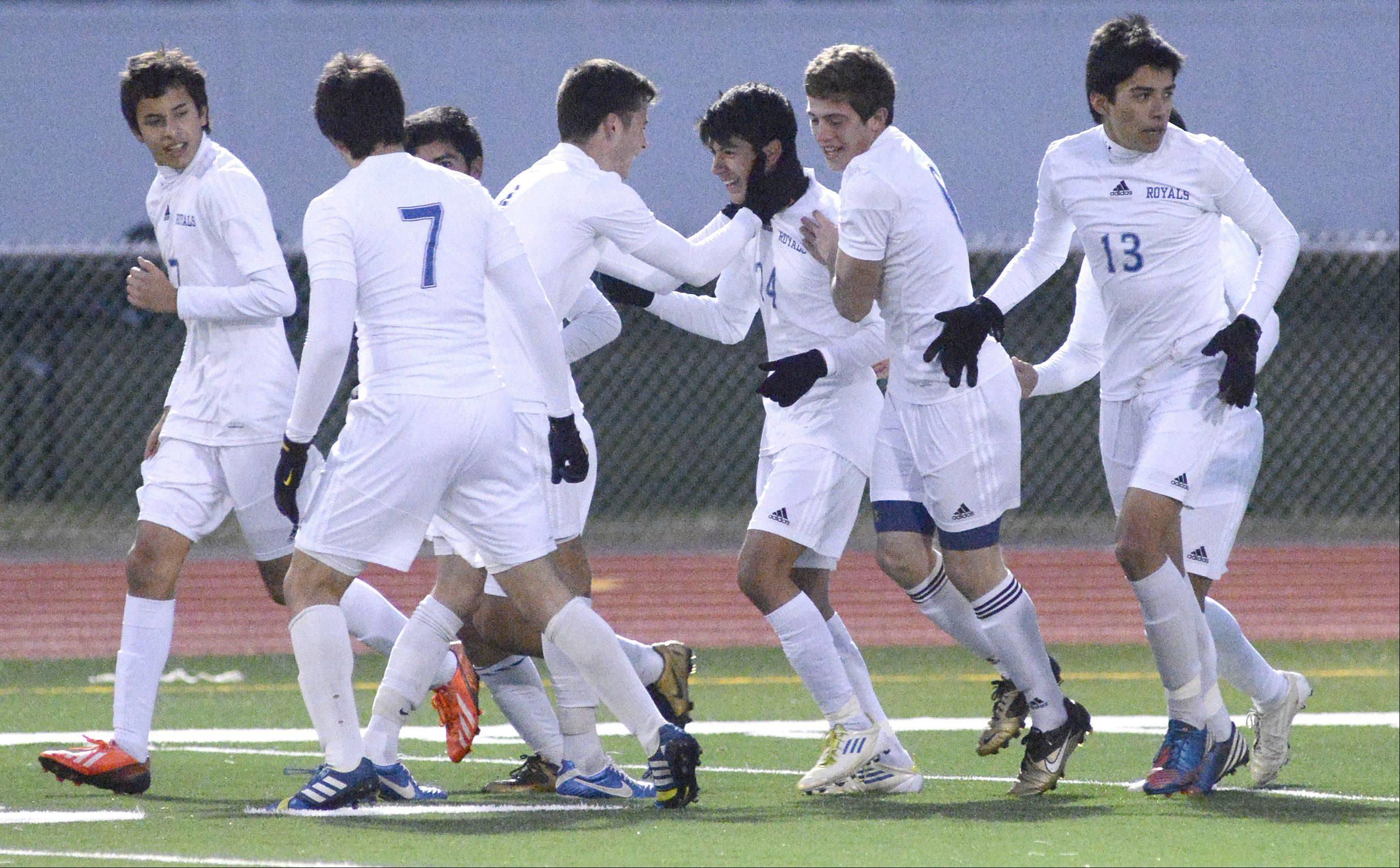 Larkin's Alex Cruz,(center, facing left) is greeted by teammate Griffen Perez after scoring a goal for the Royals in the second half of the Class 3A sectional championship at Huntley High School on Saturday, November 2.