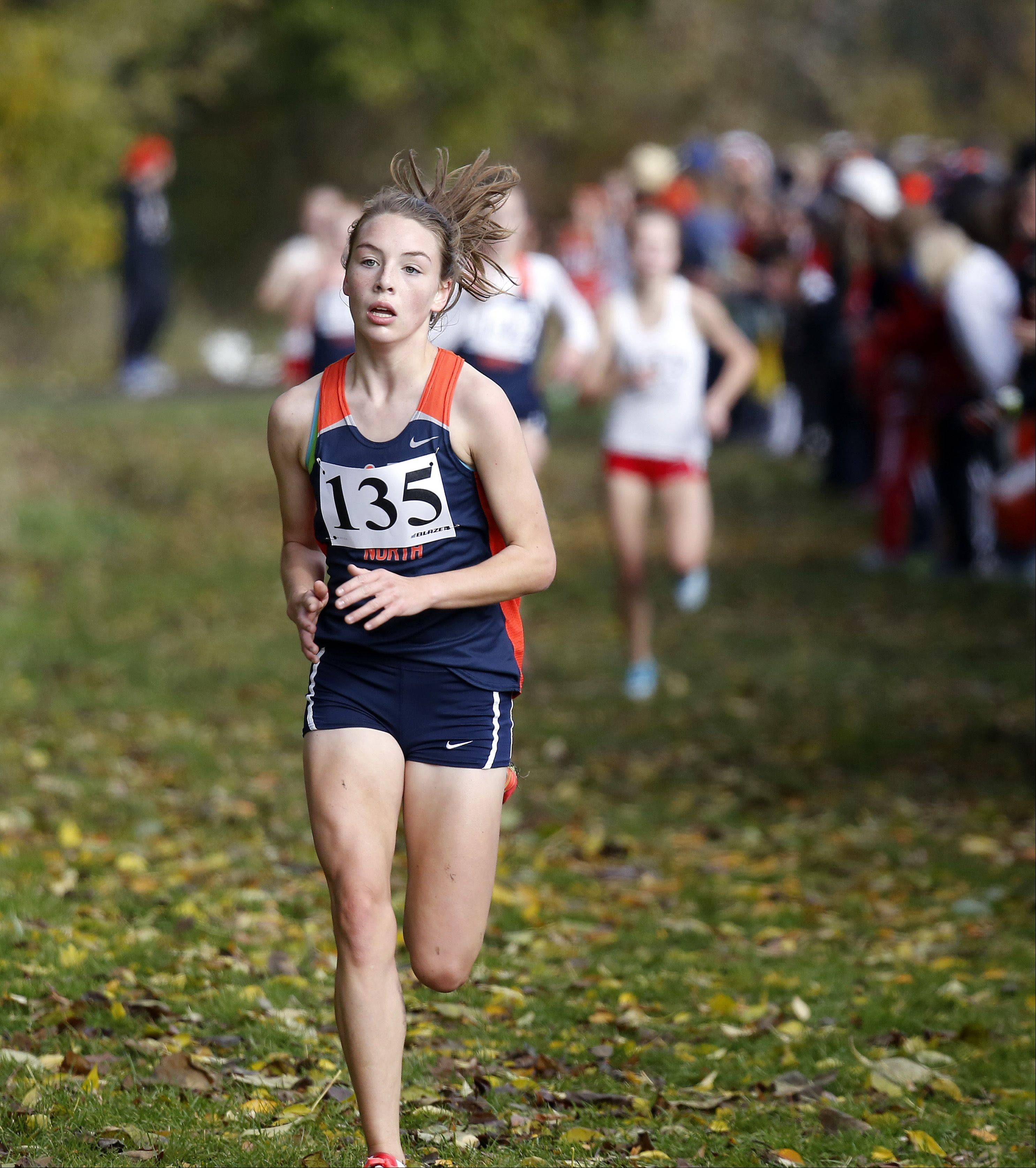Claire Hamilton of Naperville North on the way to eighth during the Waubonsie Valley girls cross country Sectional in Aurora.