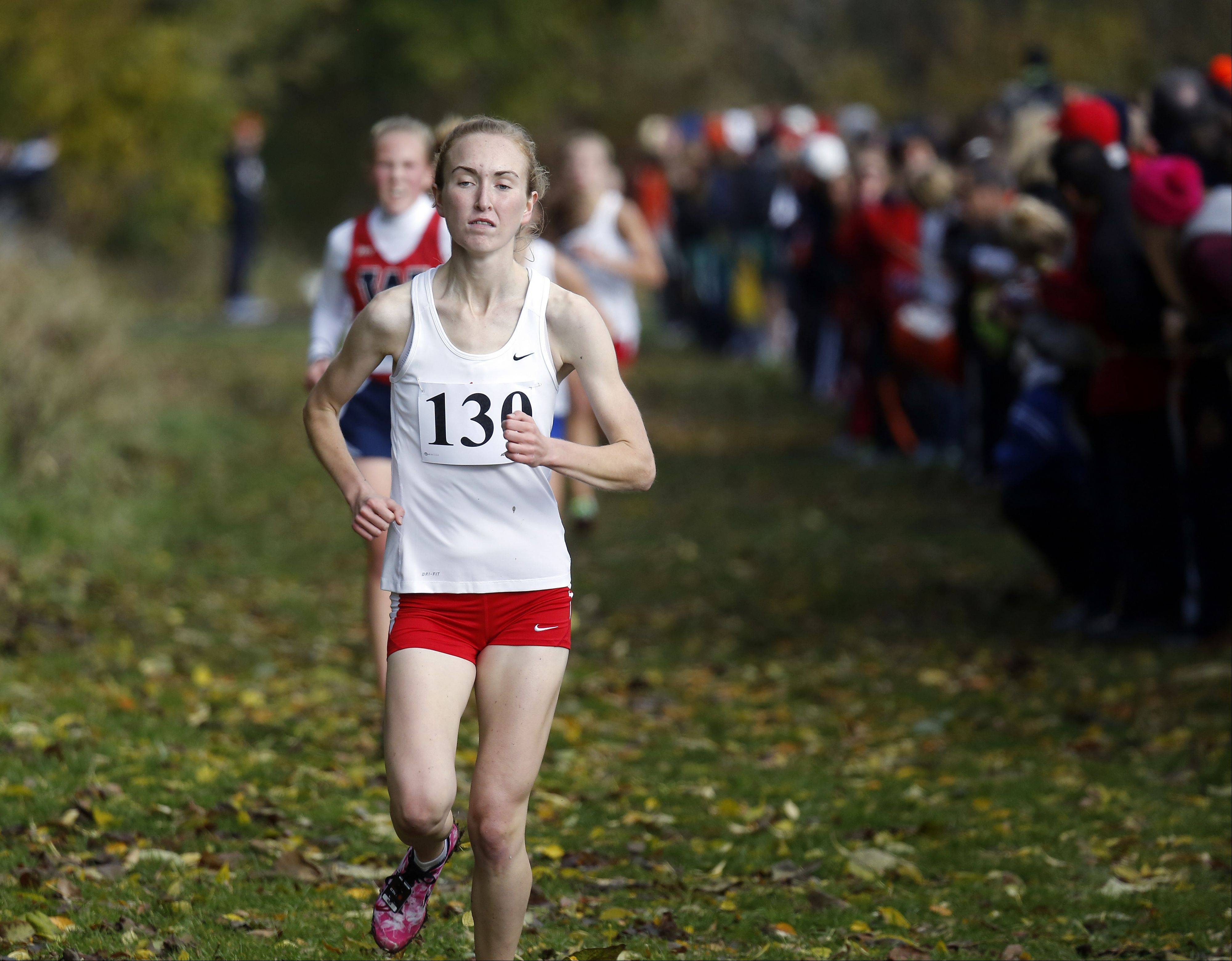 Emily White of Naperville Central on the way to 14th during the Waubonsie Valley girls cross country Sectional in Aurora.