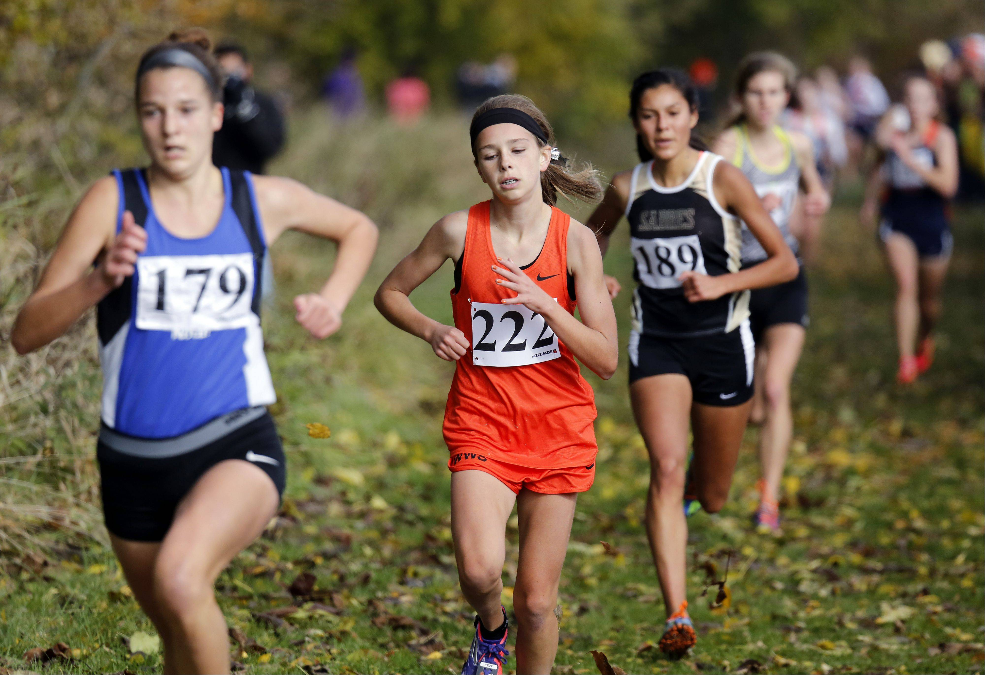 Allison McGrath of Wheaton Warrenville South heads to fifth place during the Waubonsie Valley girls cross country Sectional in Aurora.