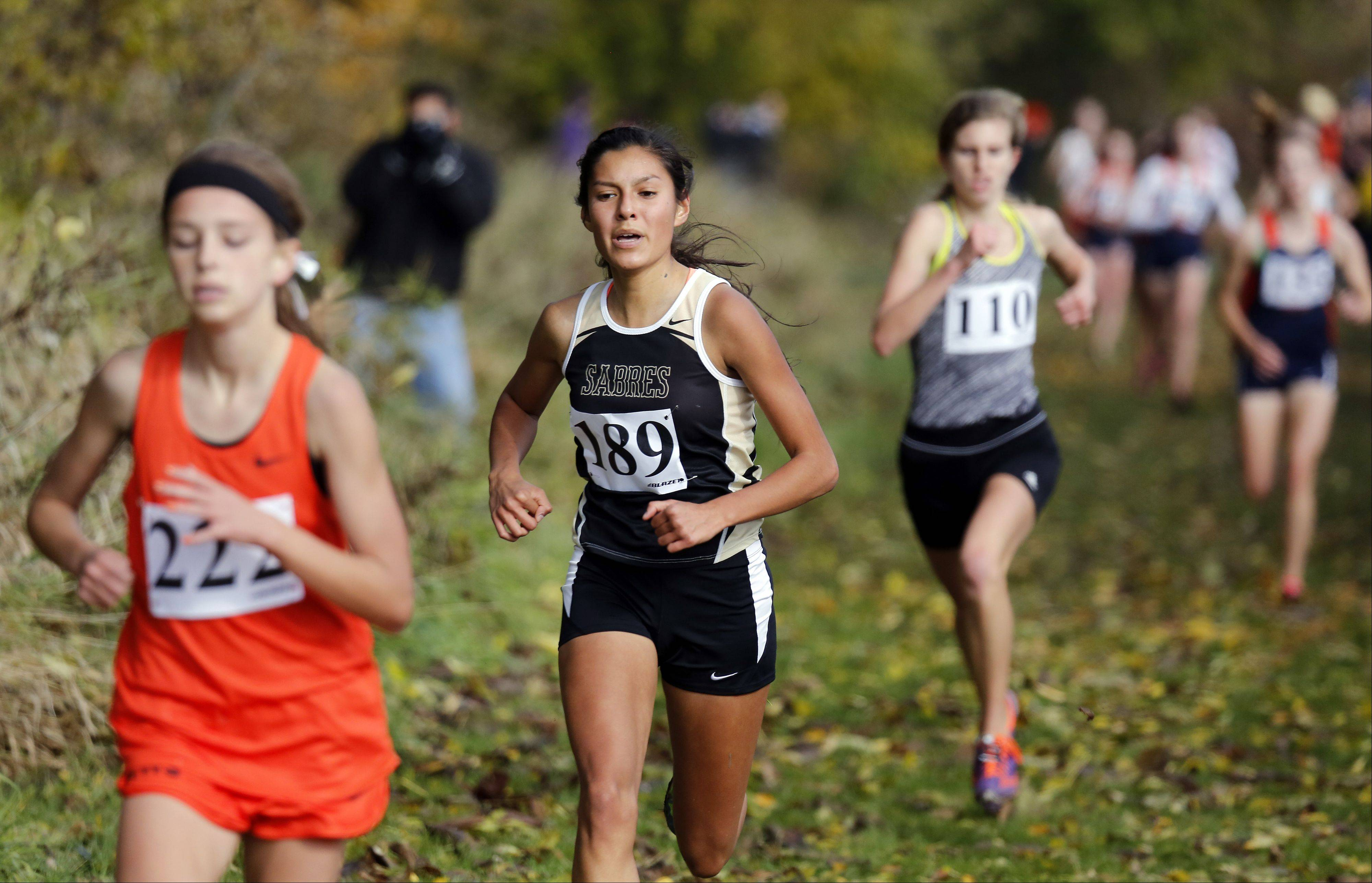 Gabby Juarez of Streamwood heads to sixth place during the Waubonsie Valley girls cross country Sectional in Aurora.