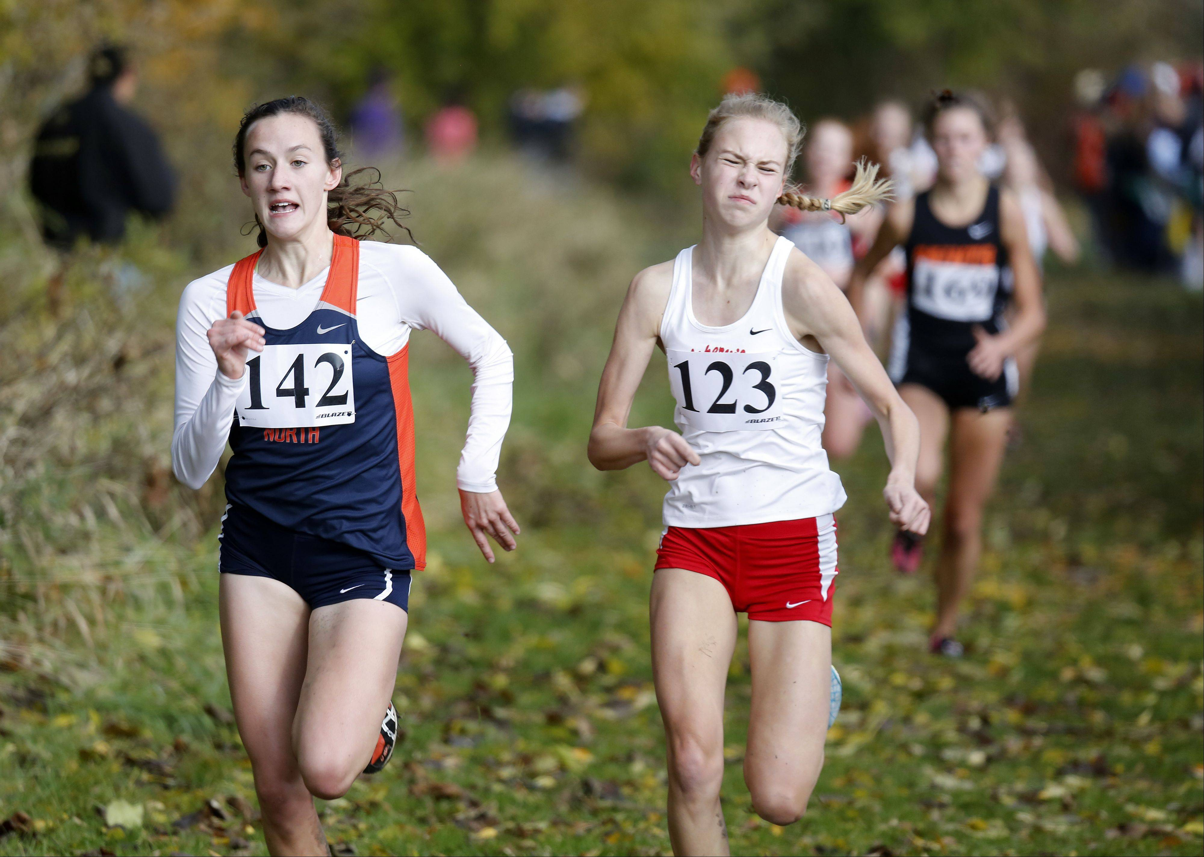 Kate Shanon of Naperville North on the way to ninth and Katie Hoffman of Naperville Central heads to 10th during the Waubonsie Valley girls cross country Sectional in Aurora.