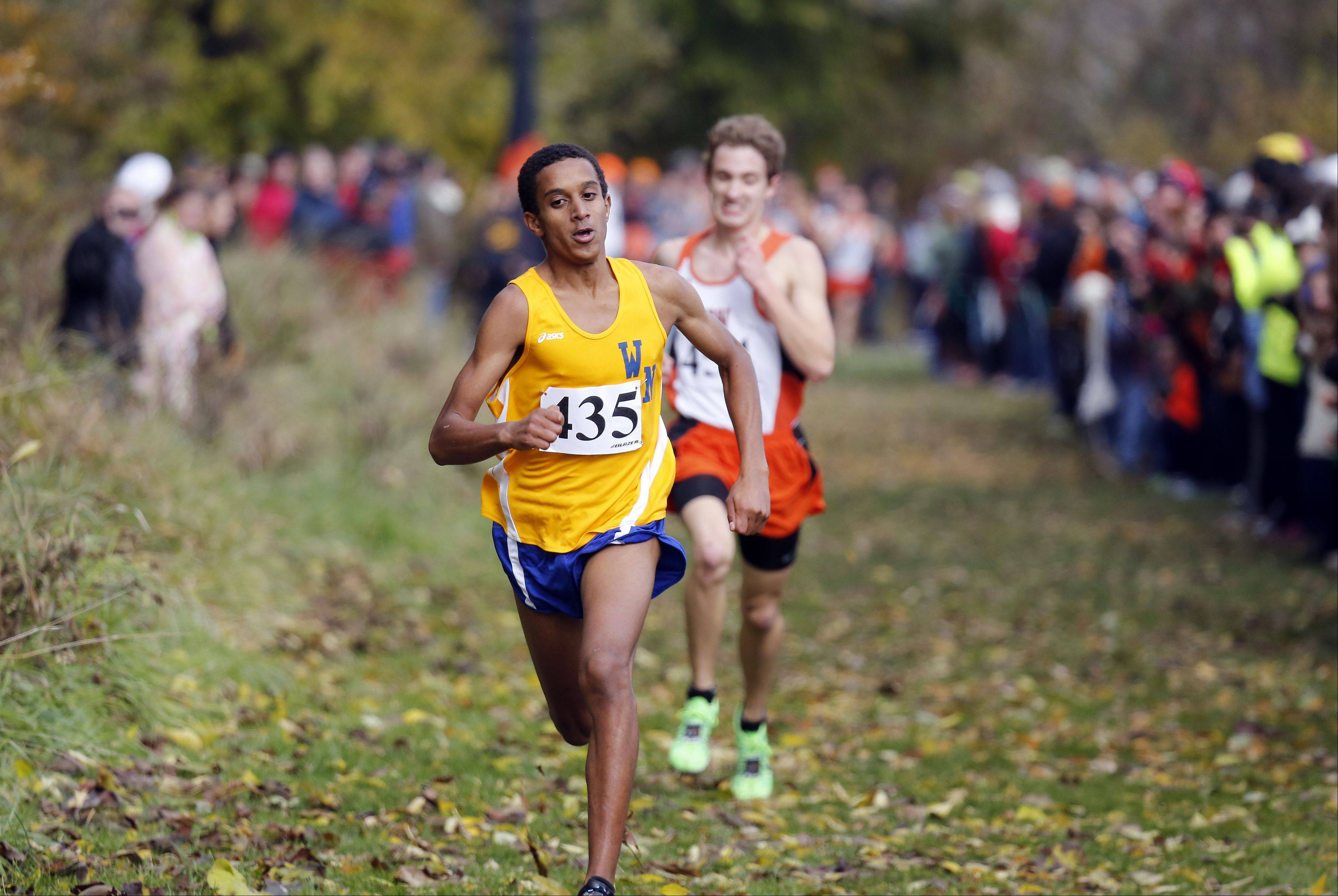 Wheaton North's Joseph Emmanuel on the way to first during the Waubonsie Valley boys cross country Sectional in Aurora.