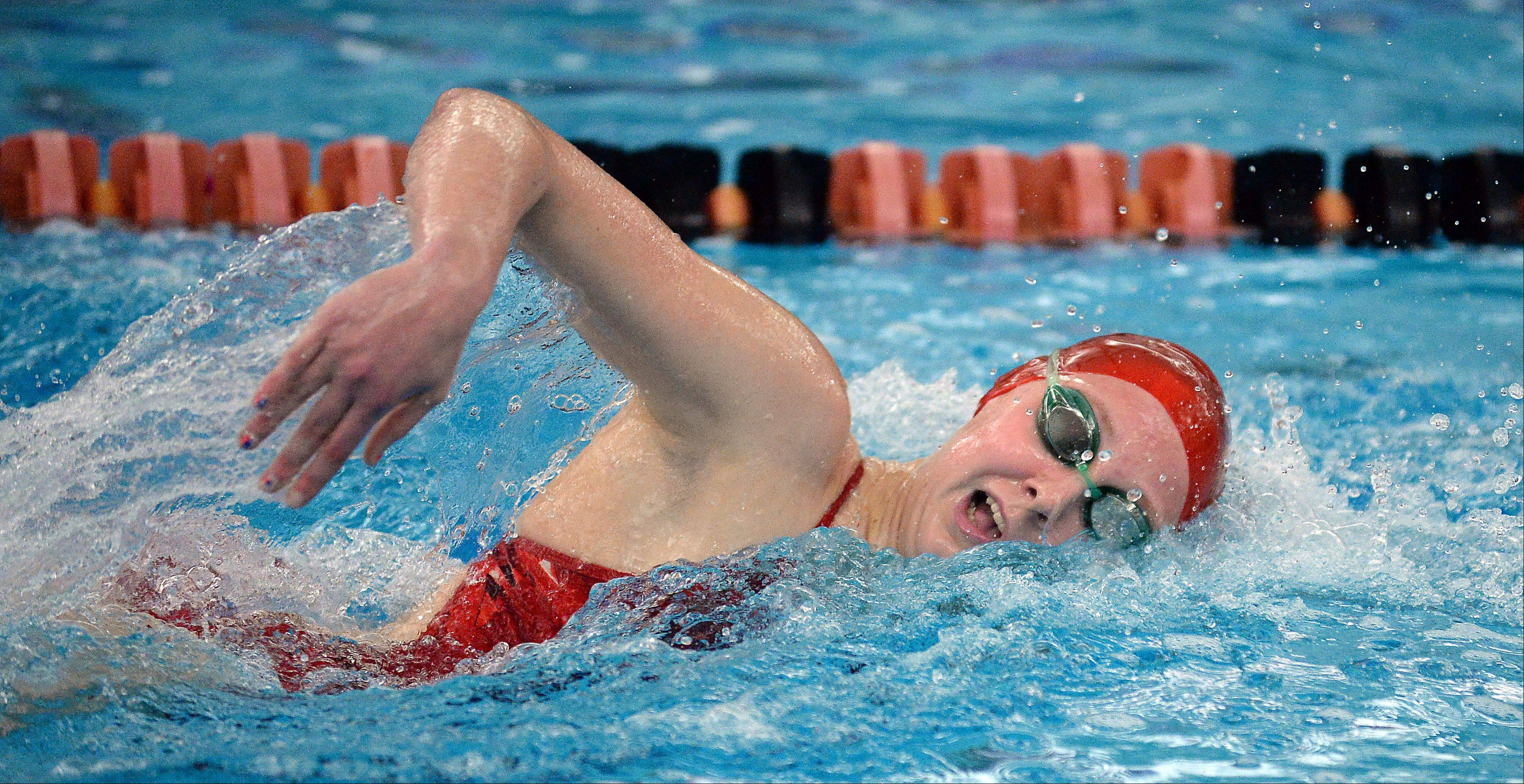 Barrington's Kirsten Jacobsen has a commanding lead in the 500-yard freestyle on her way to victory in a meet-record time in the Mid-Suburban League championships in Barrington on Saturday.