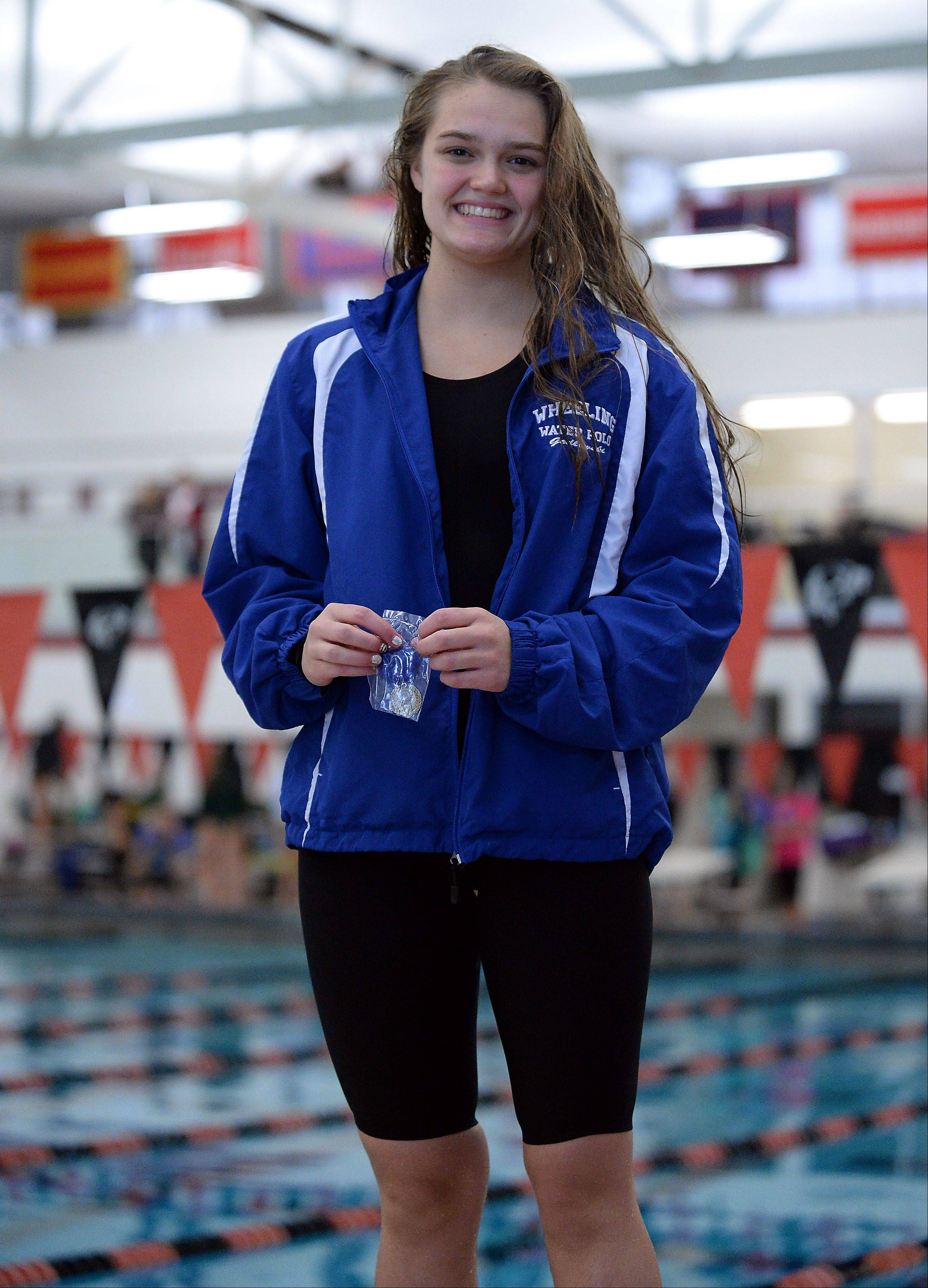 Wheeling's Theresa Godlewski is all smiles after winning the 50-yard freestyle at the Mid-Suburban League championships in Barrington on Saturday.