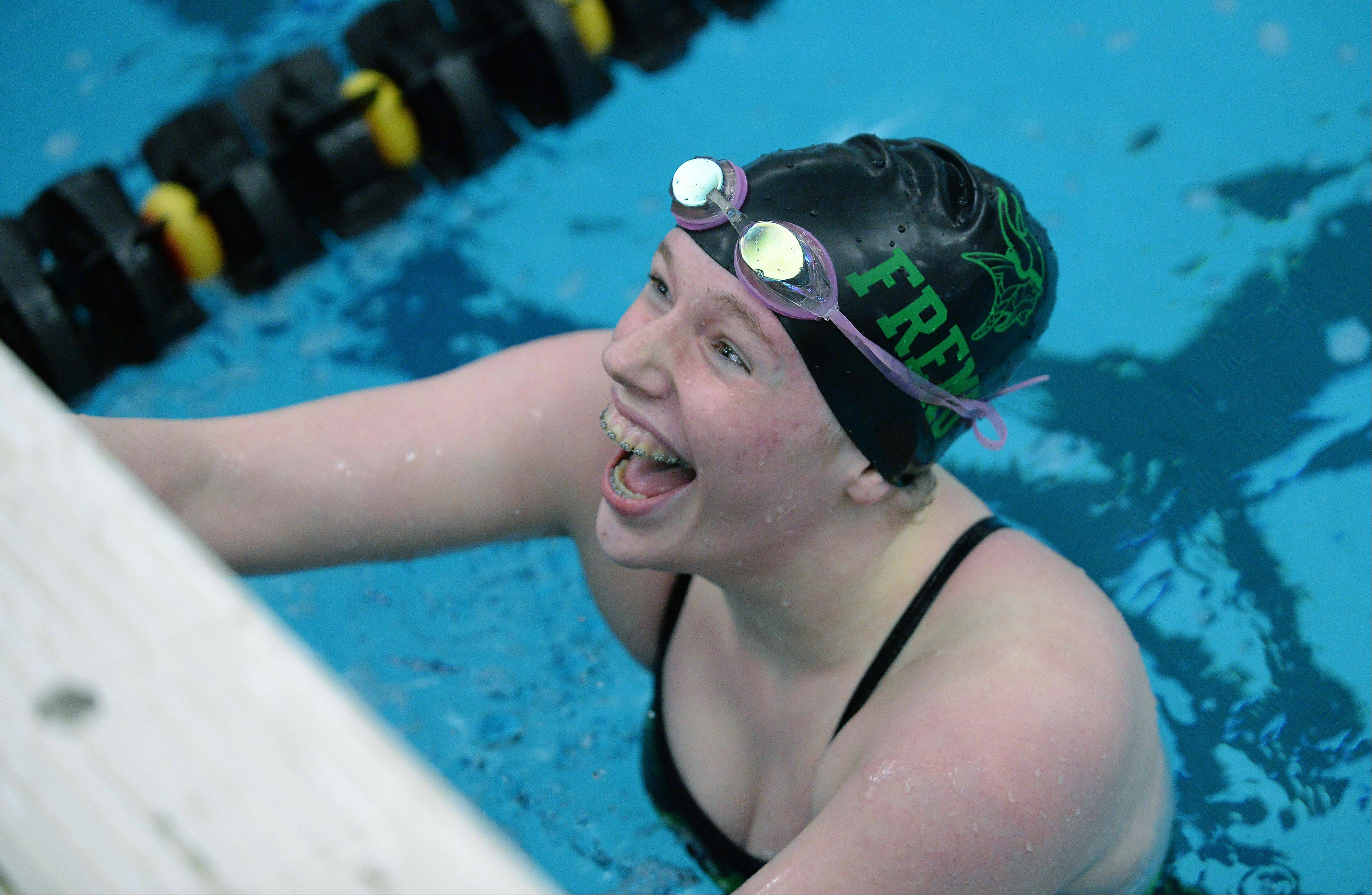 Fremd's Christine Osborn is all smiles after winning the 100-yard butterfly at the Mid-Suburban League championships in Barrington on Saturday.