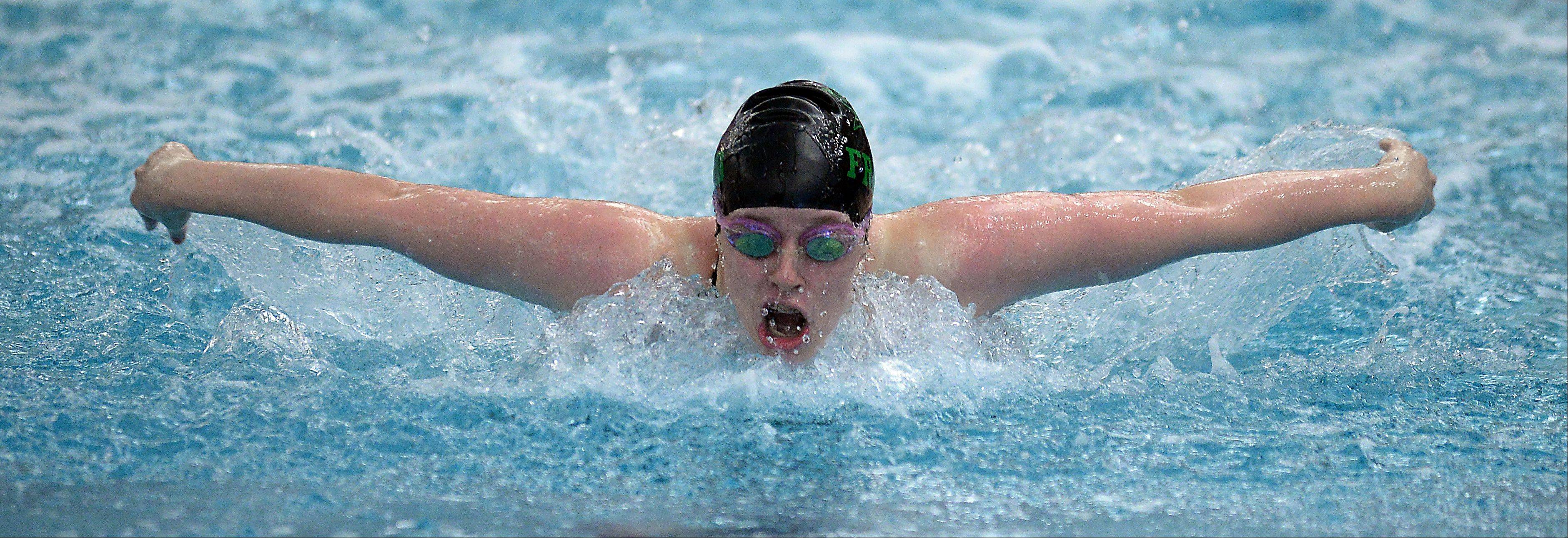 Fremd's Christine Osborn powers ahead for a victory in the 100-yard butterfly at the Mid-Suburban League championships in Barrington on Saturday.