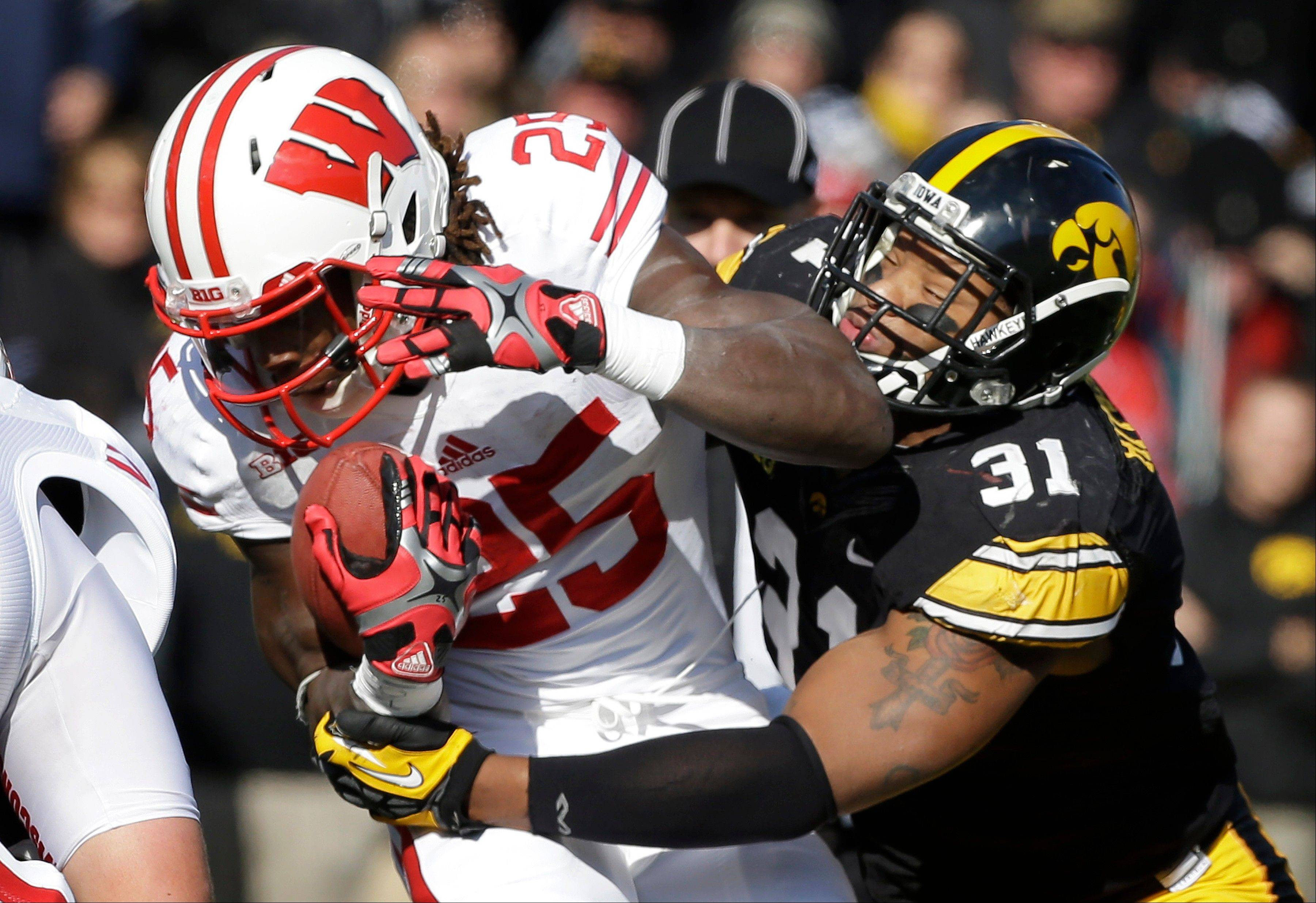 Iowa linebacker Anthony Hitchens (31) tackles Wisconsin running back Melvin Gordon during the first half.