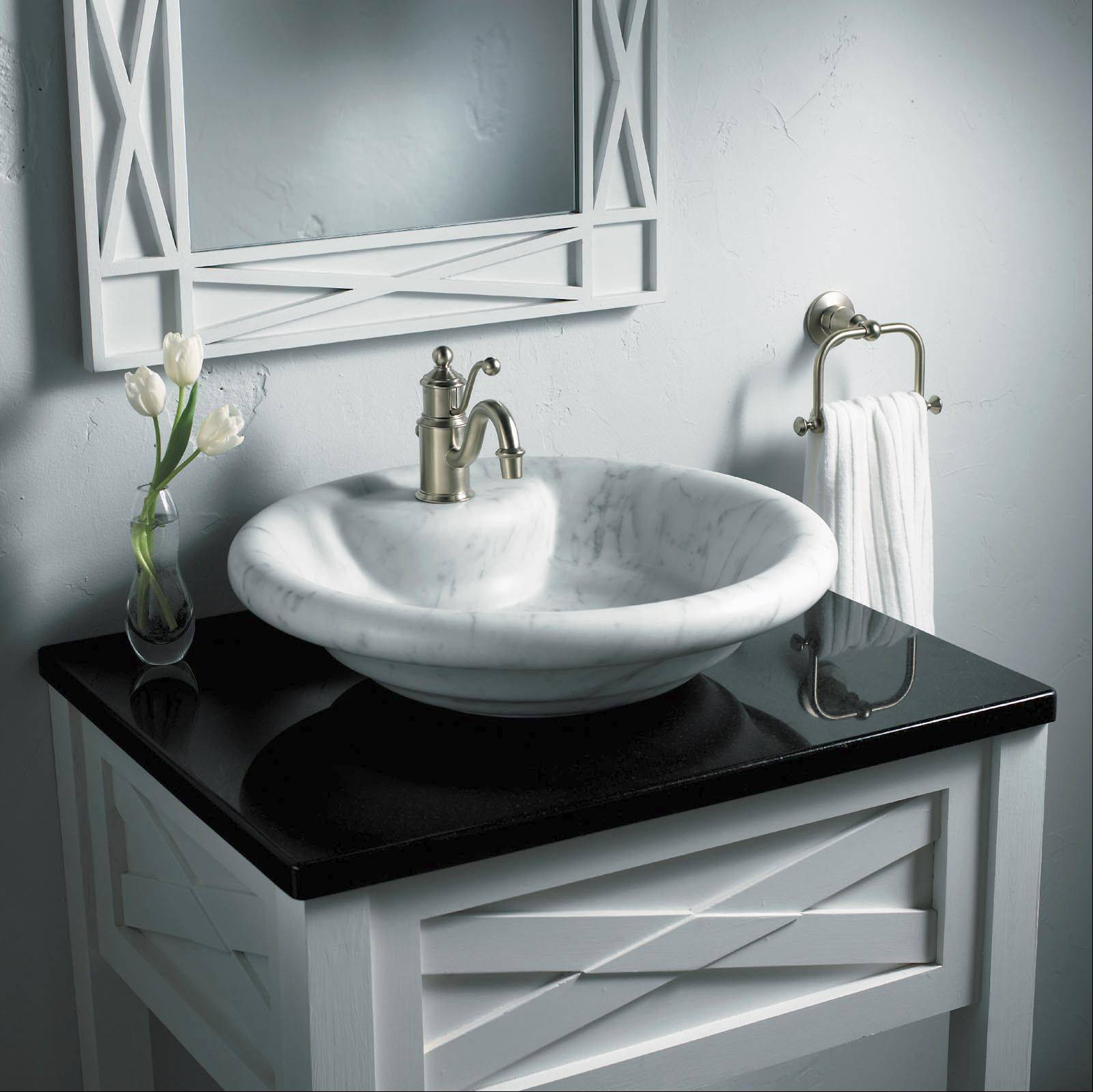 A vessel sink sits on top of the counter rather than being mounted in or below the countertop.