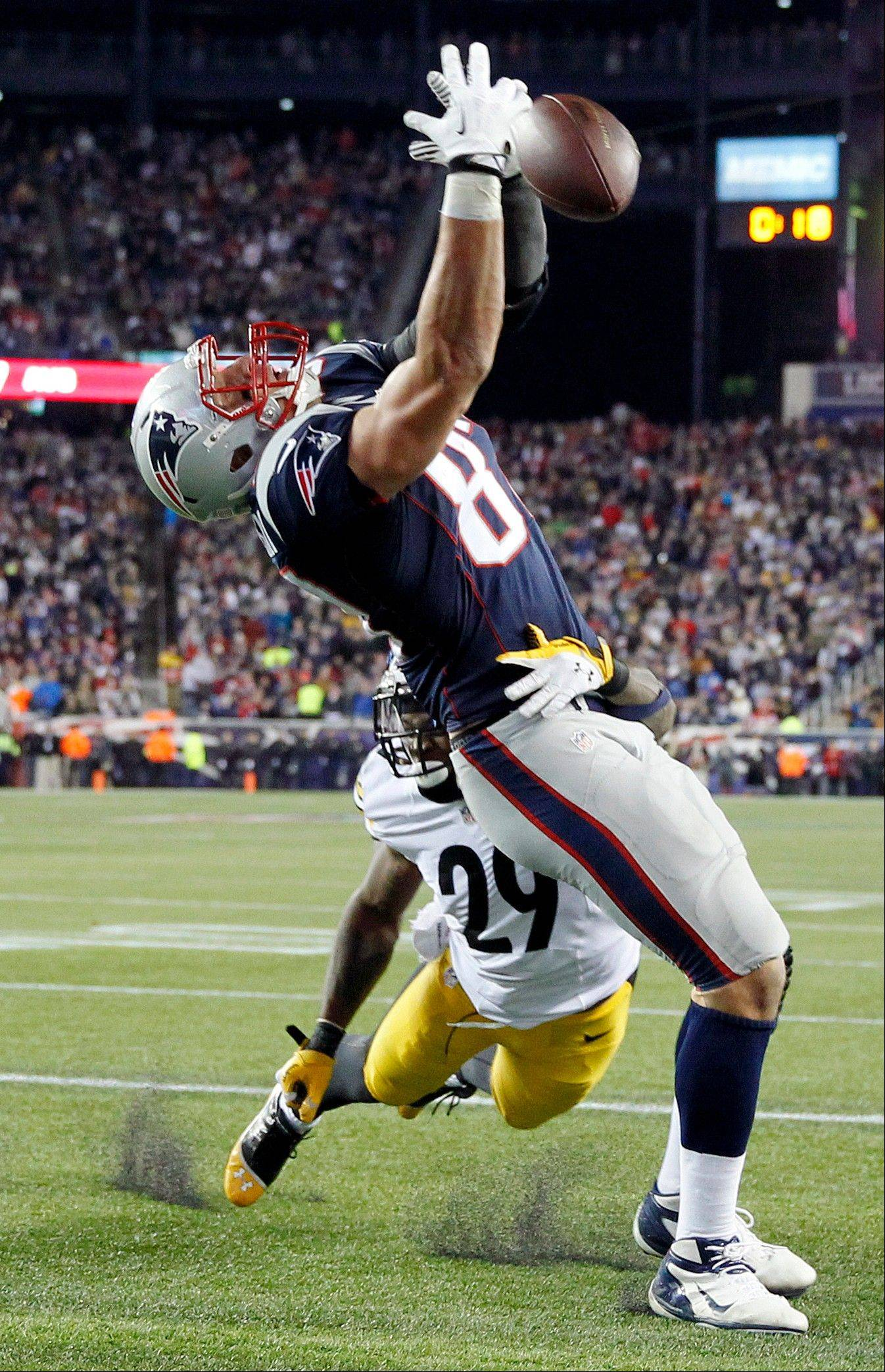 New England Patriots tight end Rob Gronkowski, top, can�t catch a pass as Pittsburgh Steelers strong safety Shamarko Thomas (29) defends in the second quarter of an NFL football game Sunday, Nov. 3, 2013, in Foxborough, Mass.