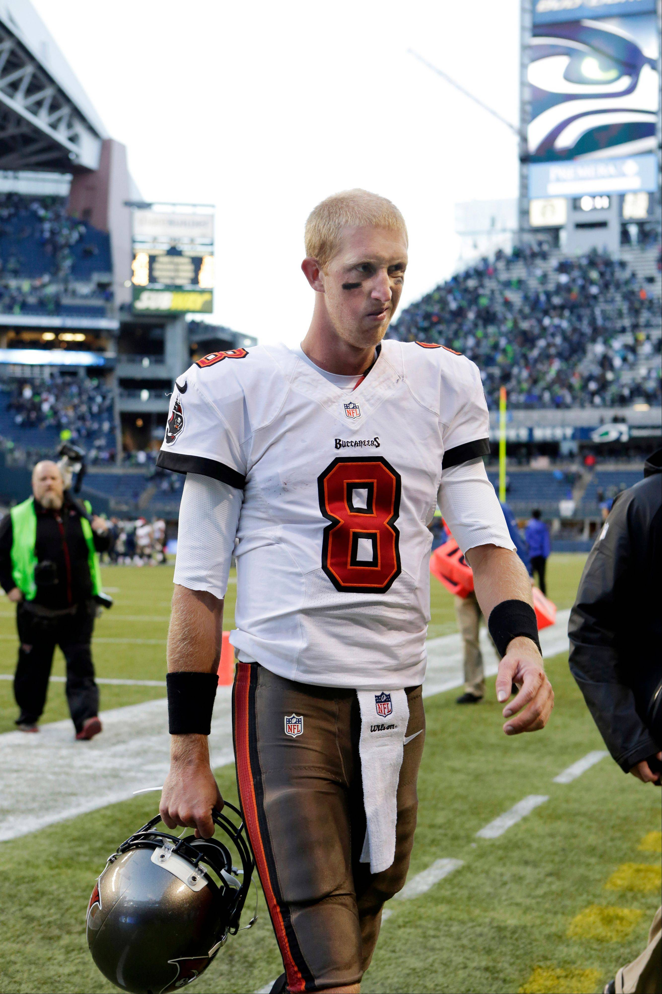 Tampa Bay Buccaneers quarterback Mike Glennon walks off the field after the Buccaneers lost 27-24 to the Seattle Seahawks in overtime of an NFL football game Sunday, Nov. 3, 2013, in Seattle.