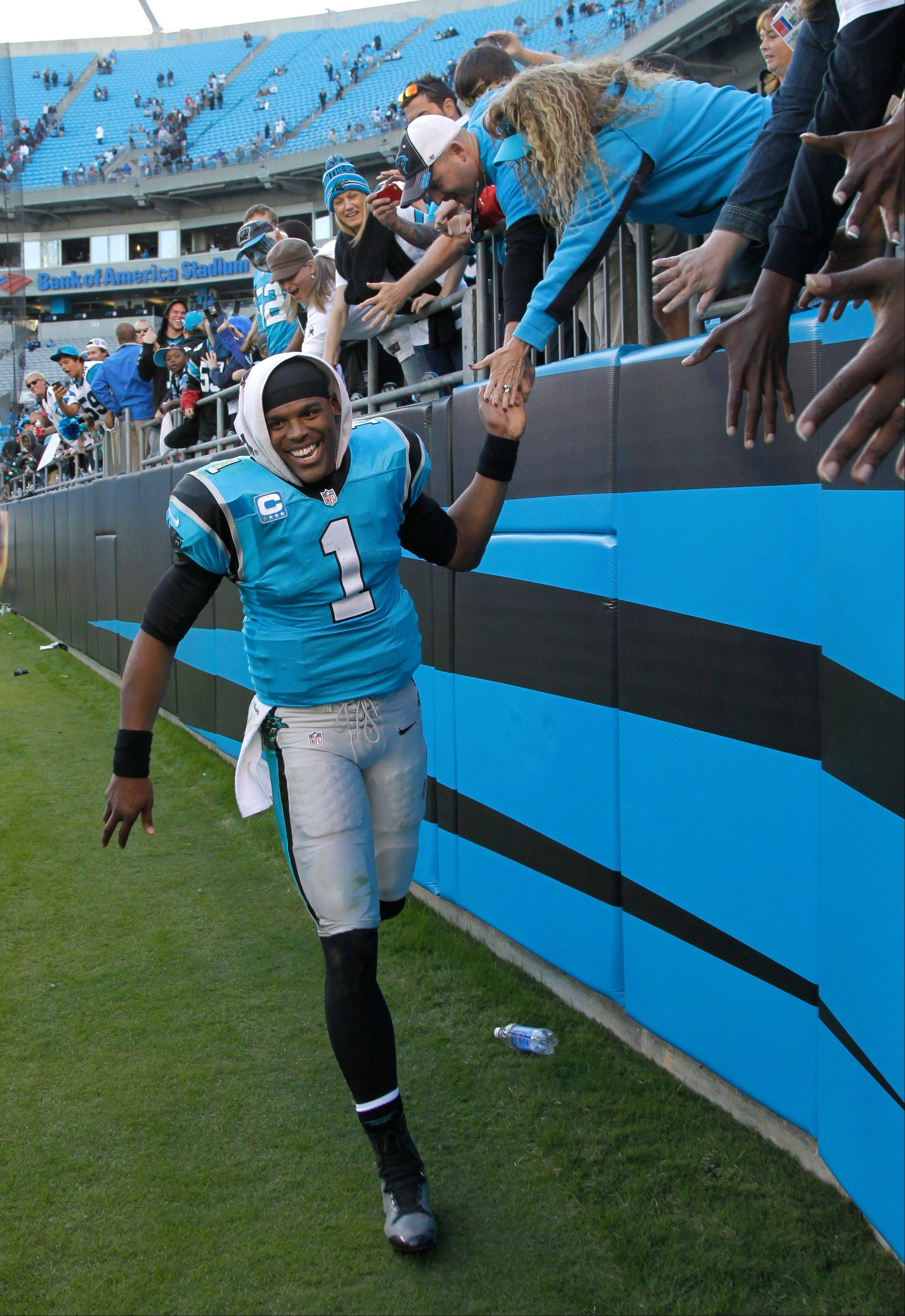 Carolina Panthers� Cam Newton (1) celebrates with fans after an NFL football game against the Atlanta Falcons in Charlotte, N.C., Sunday, Nov. 3, 2013. The Panthers won 34-10.
