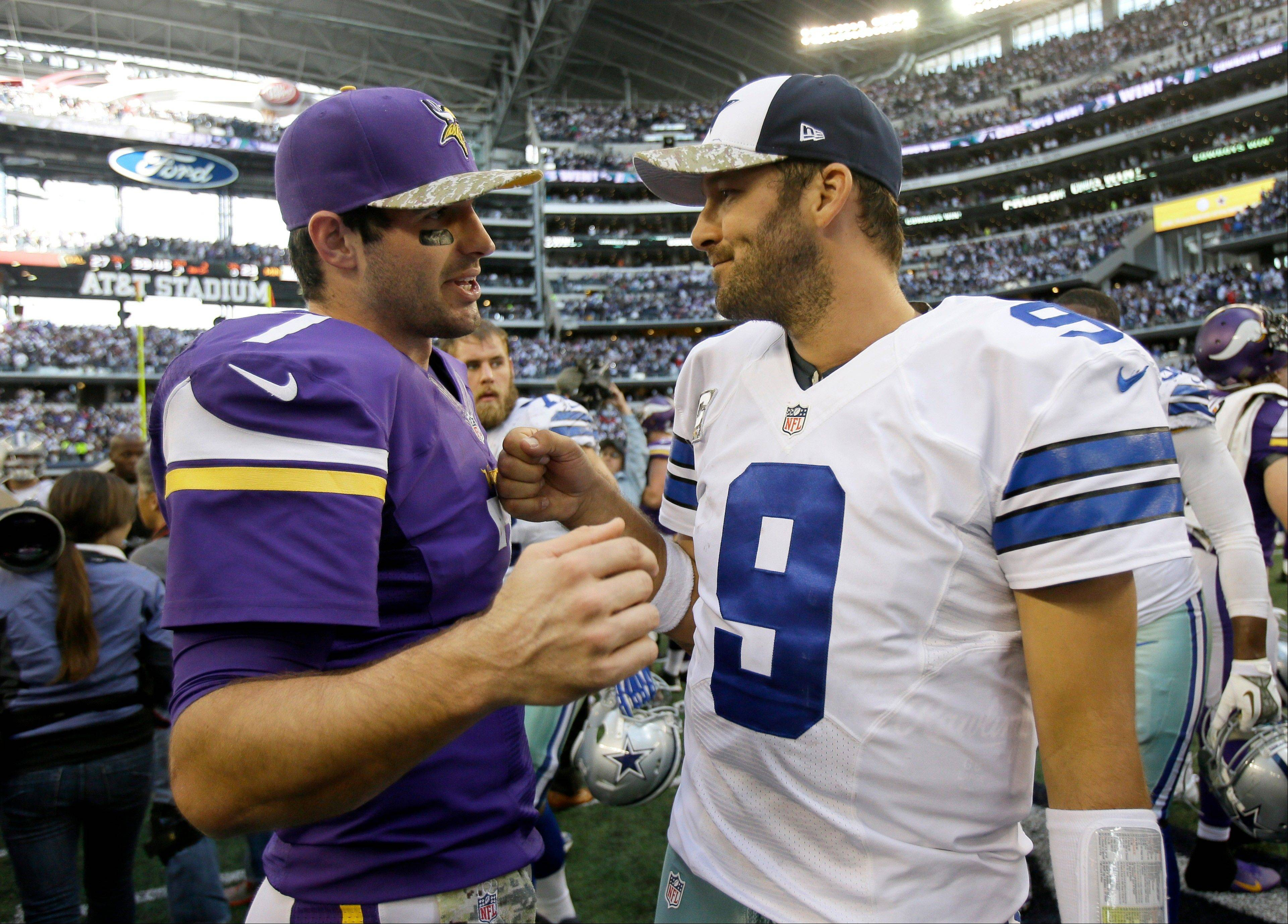 Minnesota Vikings� Christian Ponder (7) and Dallas Cowboys� Tony Romo (9) greet each other after their NFL football game, Sunday, Nov. 3, 2013, in Arlington, Texas. The Cowboys won 27-23.