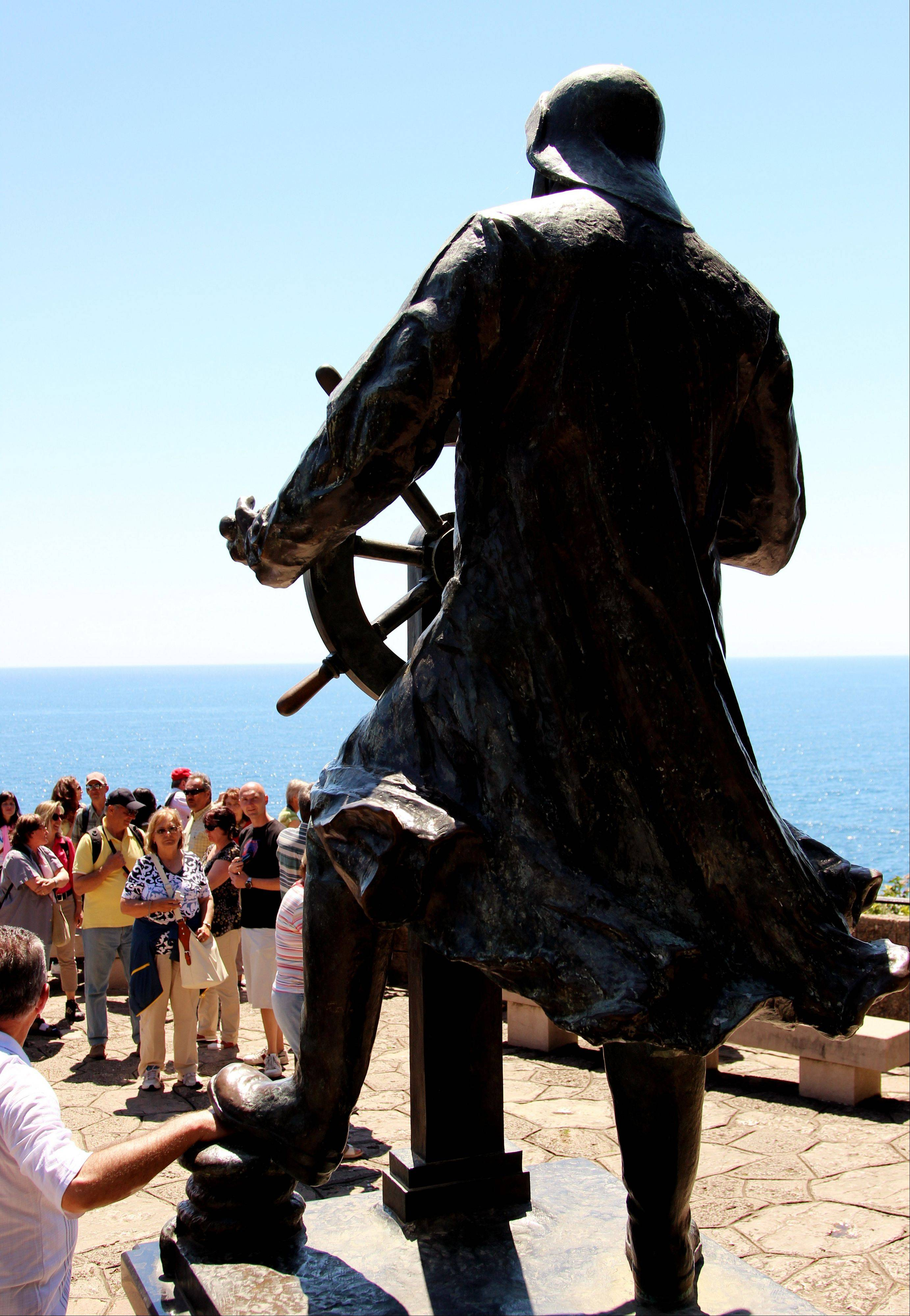 Tourists check out a larger-than-life statue of Albert I, an oceanographer who served as prince of Monaco from 1889 until his death in 1922. The statue is part of the St. Martin Gardens, which is free to visit and makes a nice place to stroll, with views of the Mediterranean.