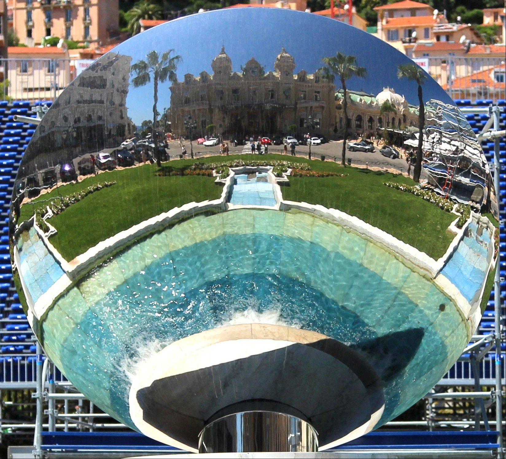 "The sculpture ""Sky Mirror"" faces the Monte Carlo Casino in Monaco. The large circular mirror reflects the building and is one of a number of free things to see in Monaco."