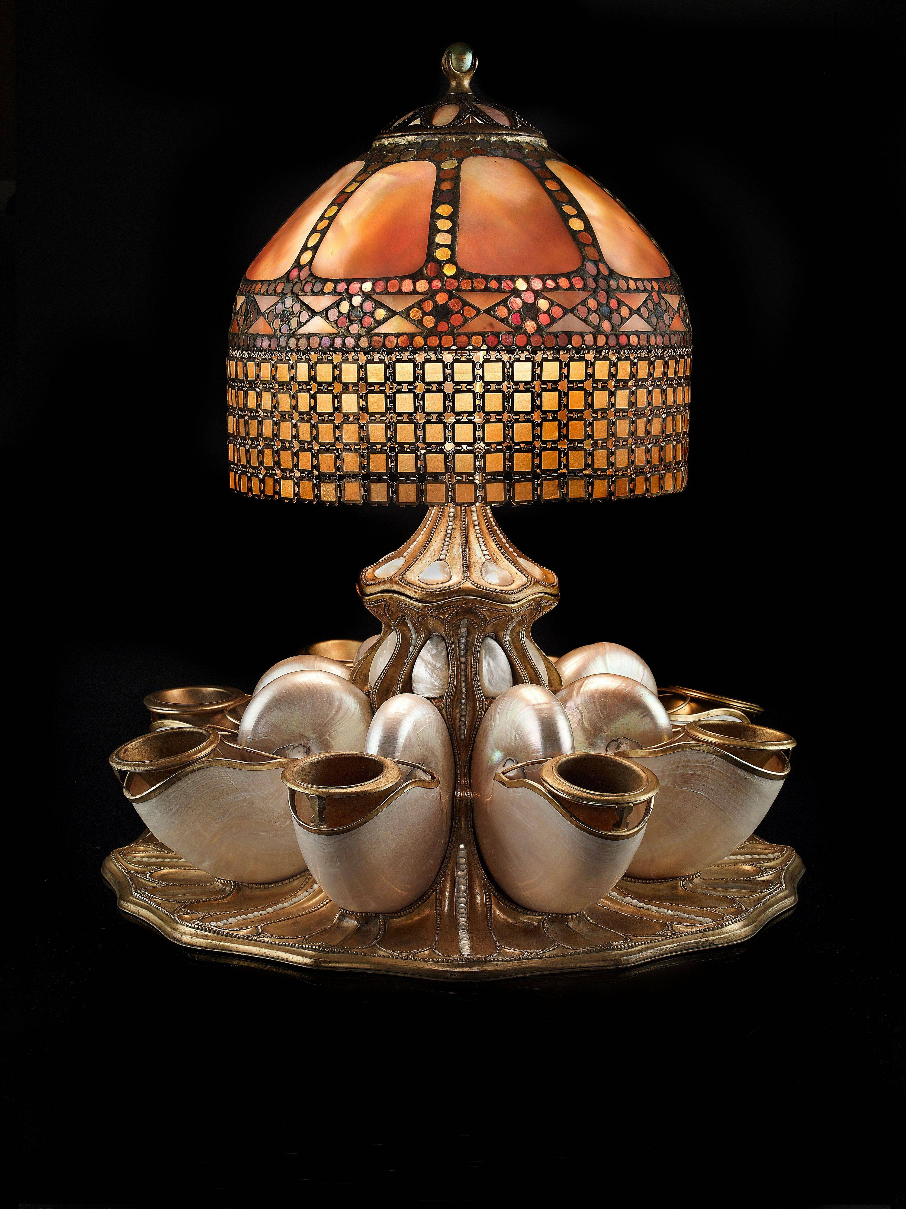 See this nautilus shell centerpiece lamp from 1910 at the new Tiffany exhibit at Chicago's Richard H. Driehaus Museum.