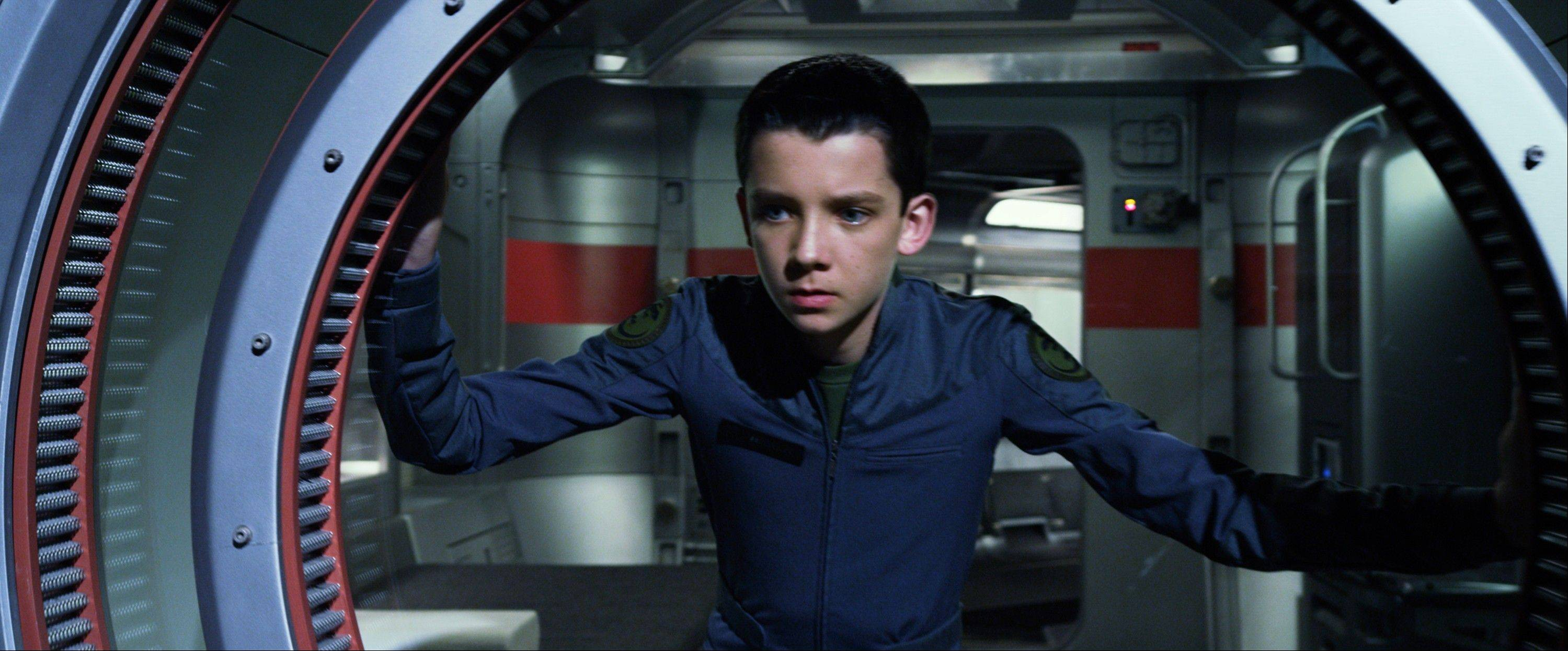 "This publicity photo released by Summit Entertainment shows Asa Butterfield in a scene from the film, ""Ender's Game,"" which debuted at No. 1 in its first weekend of release."