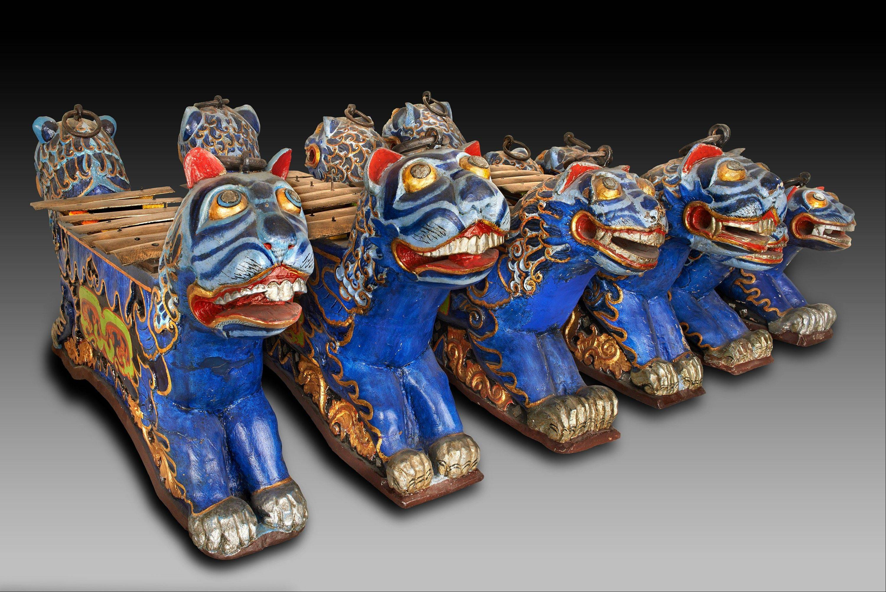 These are just a few of more than 40 pieces that compose a gamelan, a traditional Indonesian instrument that was played at the 1893 World's Fair; it is one of the Field Museum's most treasured artifacts. These lions are part of the xylophone portion.
