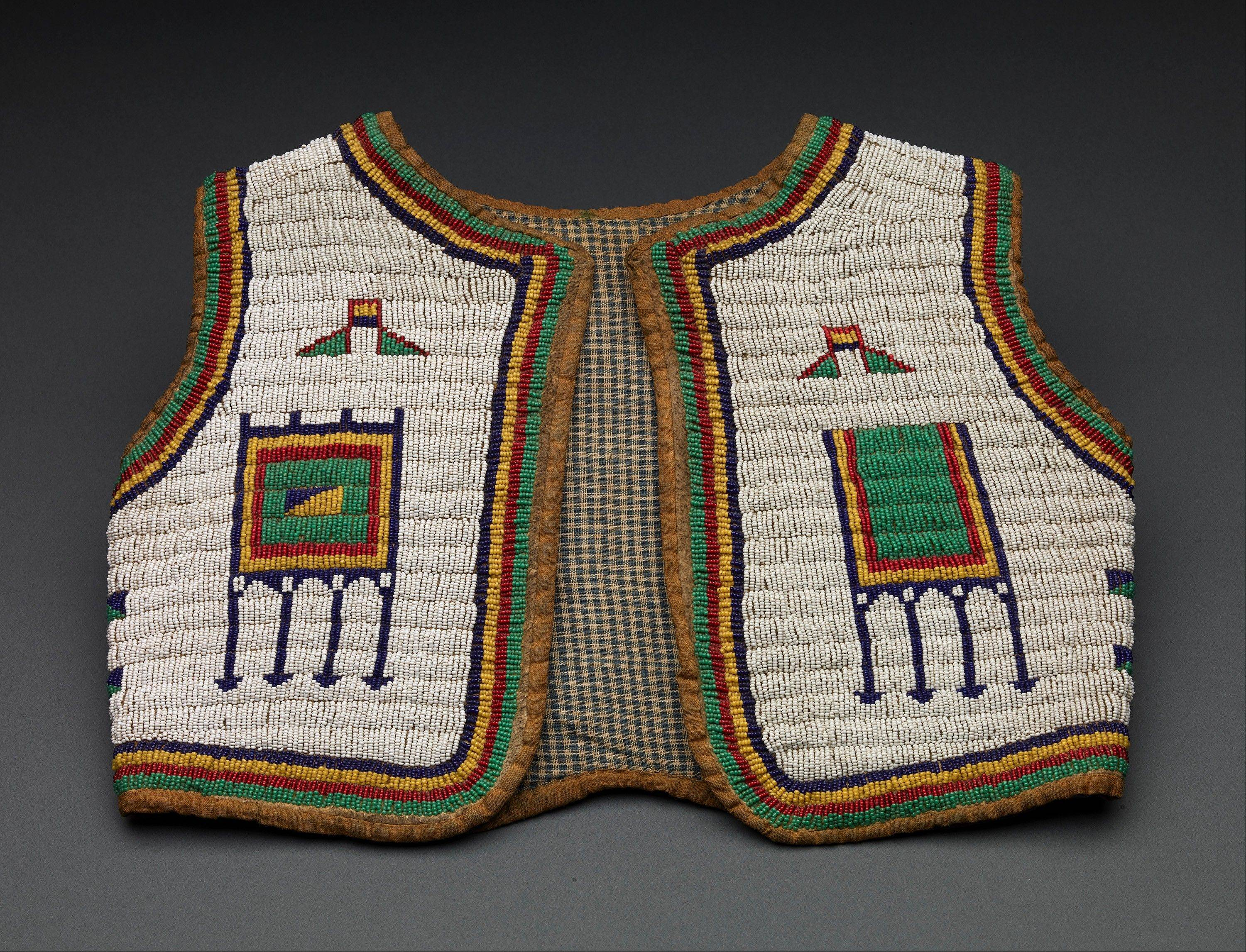"This Sioux child's vest and other Native American garments like it were worn in ""live displays,"" featuring people from different cultural groups who lived in villages within the fair. Visitors bought tickets to visit different villages where they saw other cultures' daily life, rituals and performances."
