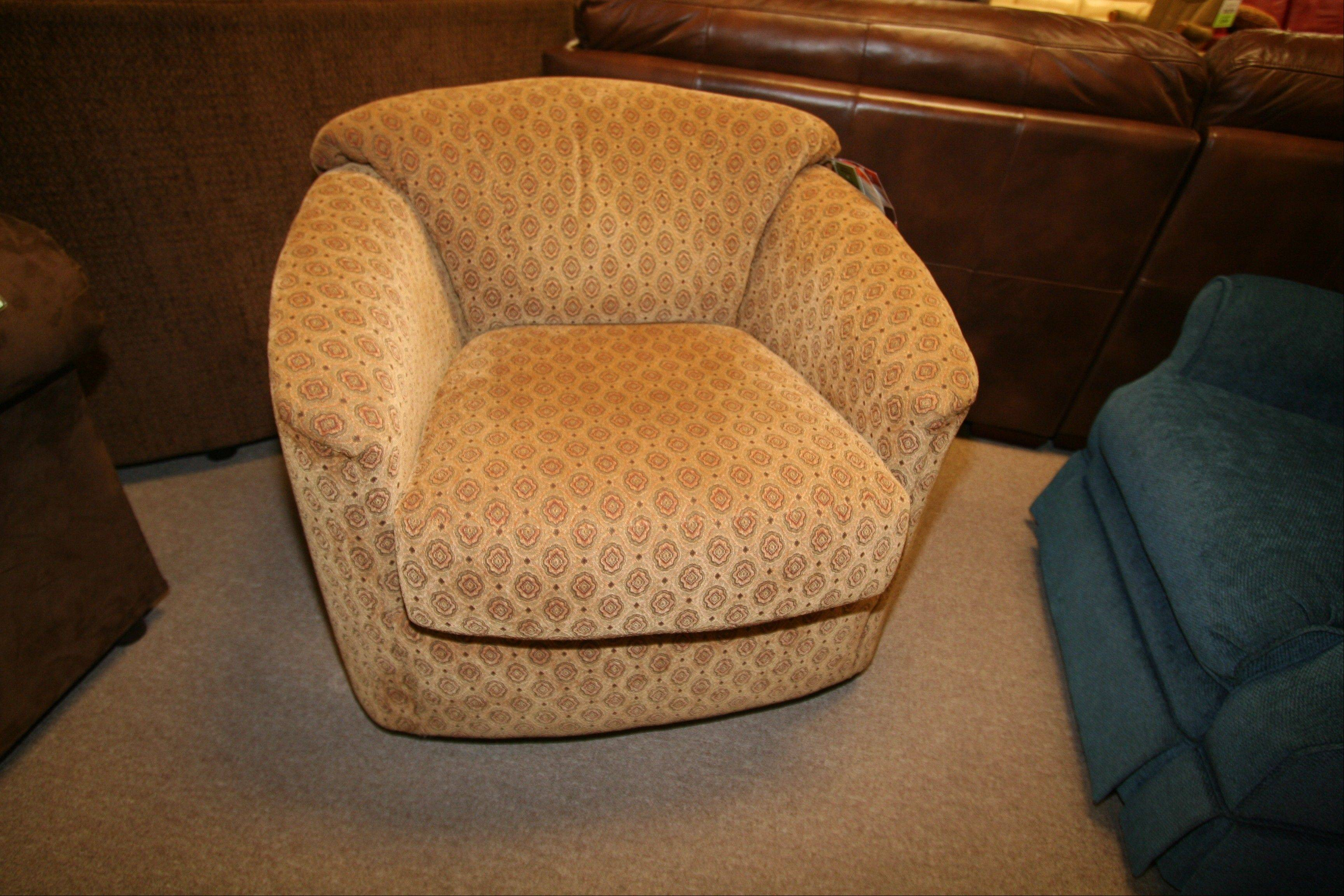 A fabric swivel chair as you enter the room is inviting.
