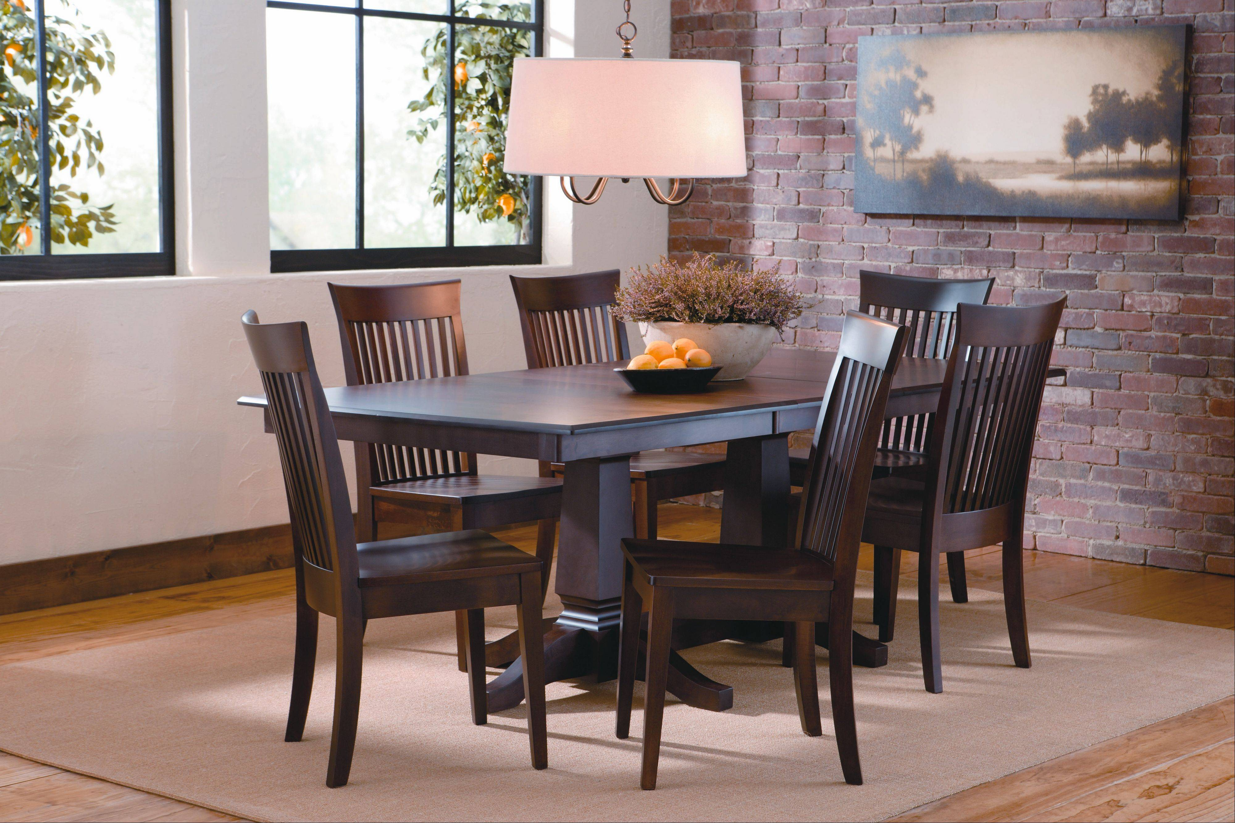Area rugs can warm up a dining room with hardwood flooring.