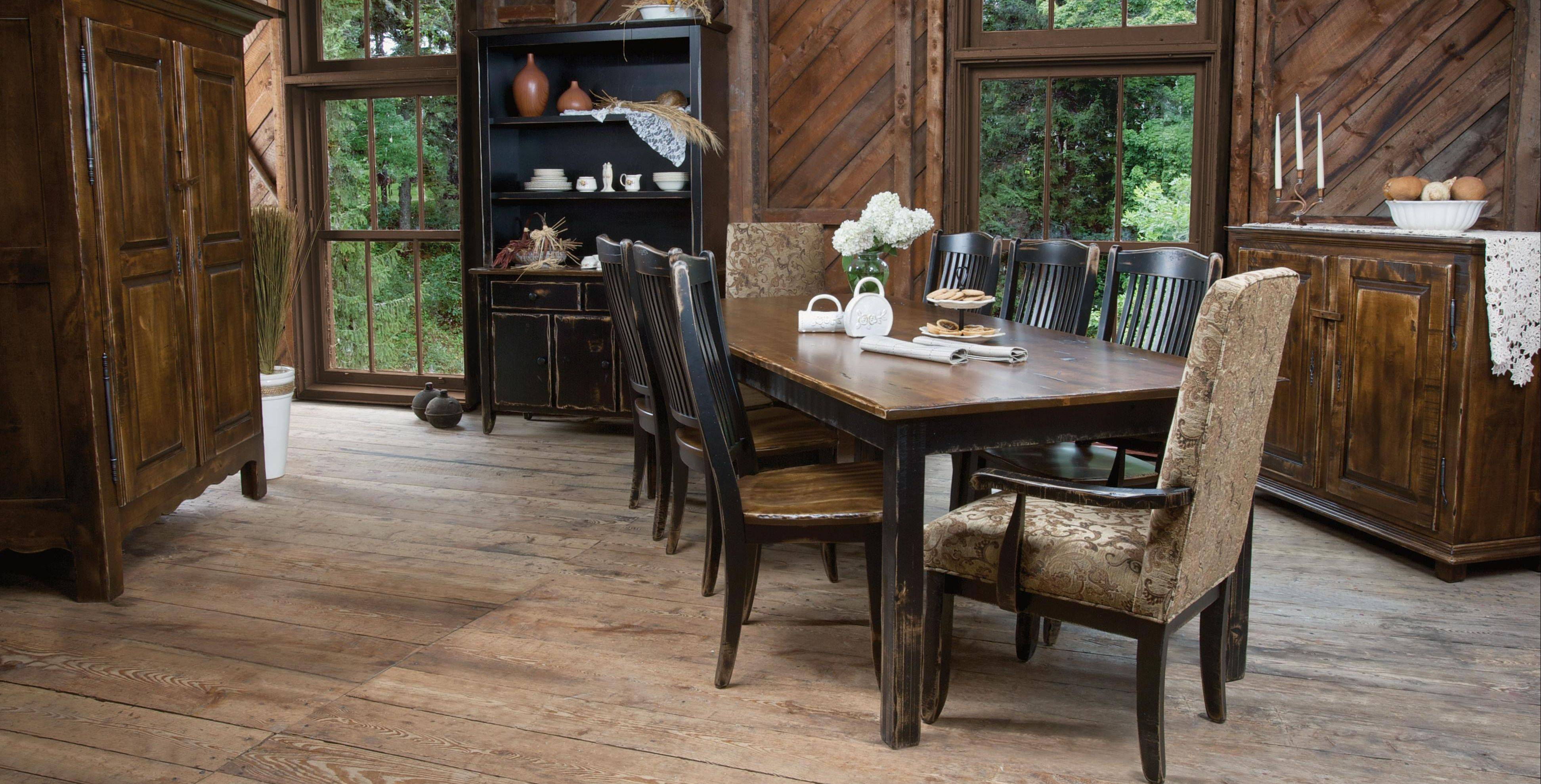 Custom-made furniture from Canadel, above, and Gacho can be ordered through the designers at Steinhafels Furniture in Vernon Hills. All-fabric Parsons chairs at the head and foot of the table breaks up the look of the wood.