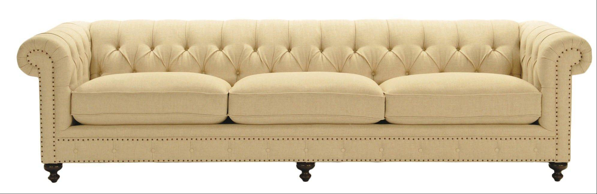 The button-tufted, rolled-back Chesterfield sofa is popular among homeowners who are choosing them in linen or distressed leather.