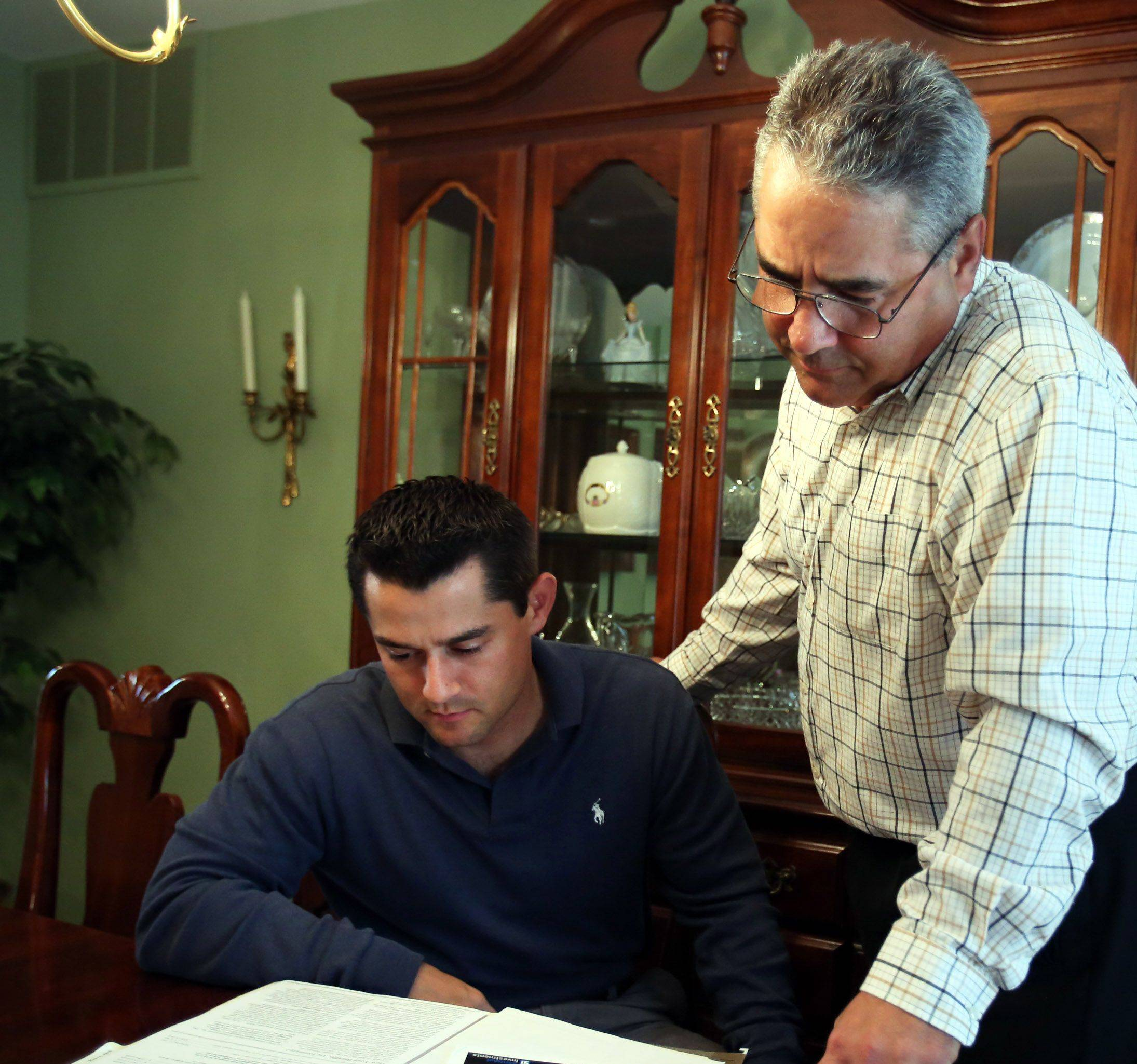 Financial planner Peter Gennuso, right, with his son his son Matthew Gennuso at Peter's home in Schaumburg.