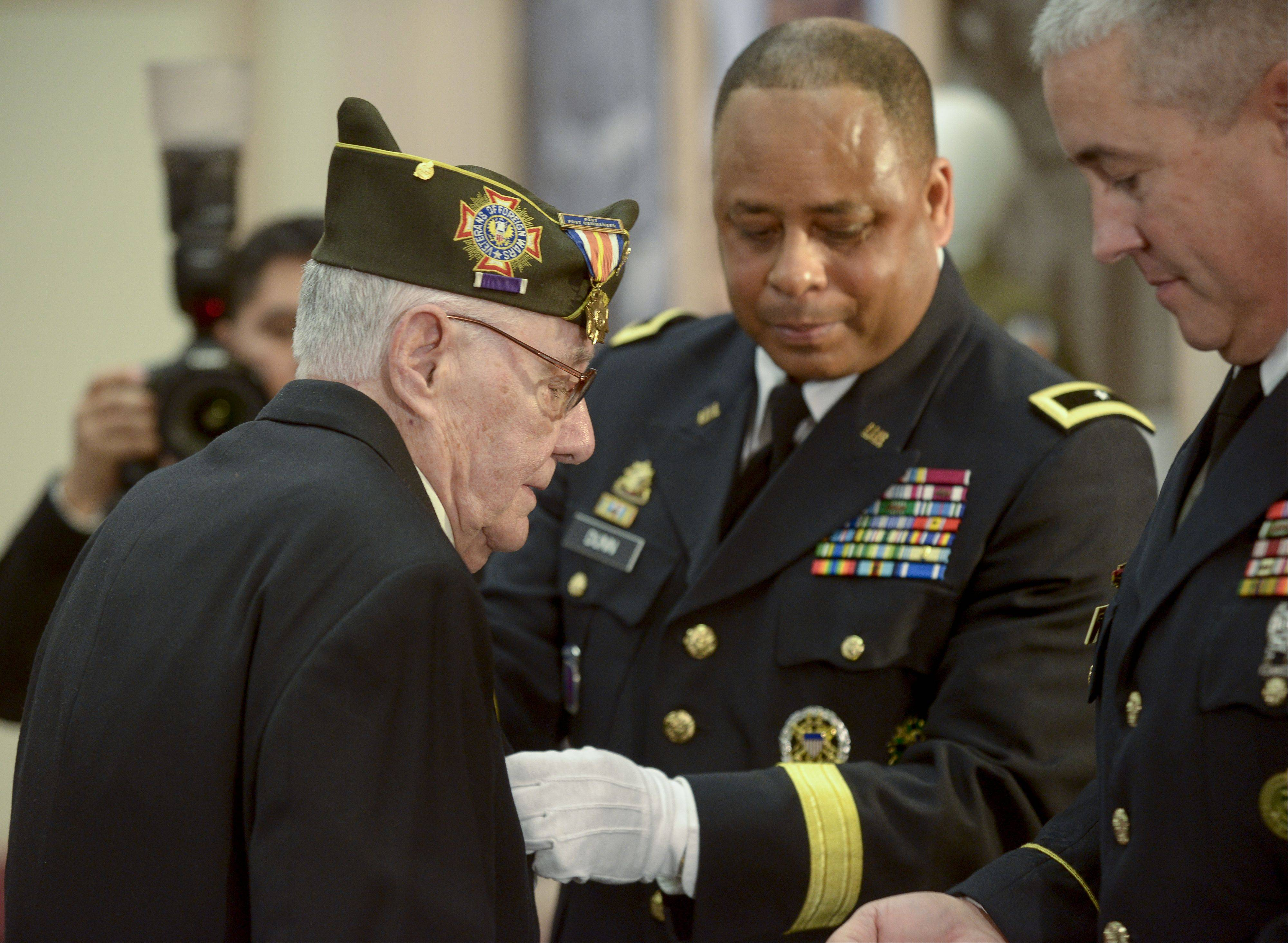 Brigadier General Gracus K. Dunn awards Frank Andrews of Des Plaines the six medals he earned during his service with the U.S. Army in World War II. The medals included a Purple Heart. Andrews was injured on D-Day and in the Battle of the Bulge.