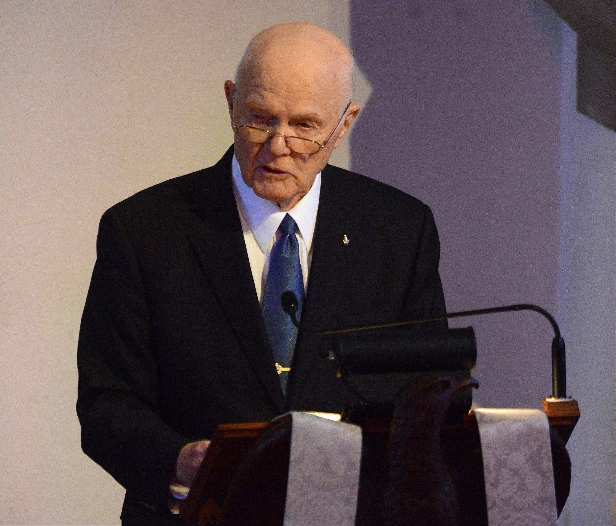Senator John Glenn gives a eulogy during the funeral of fellow astronaut Scott Carpenter on Saturday, Nov. 2, 2013, in Boulder, Colo. Carpenter was the second American to orbit the Earth, following John Glenn.