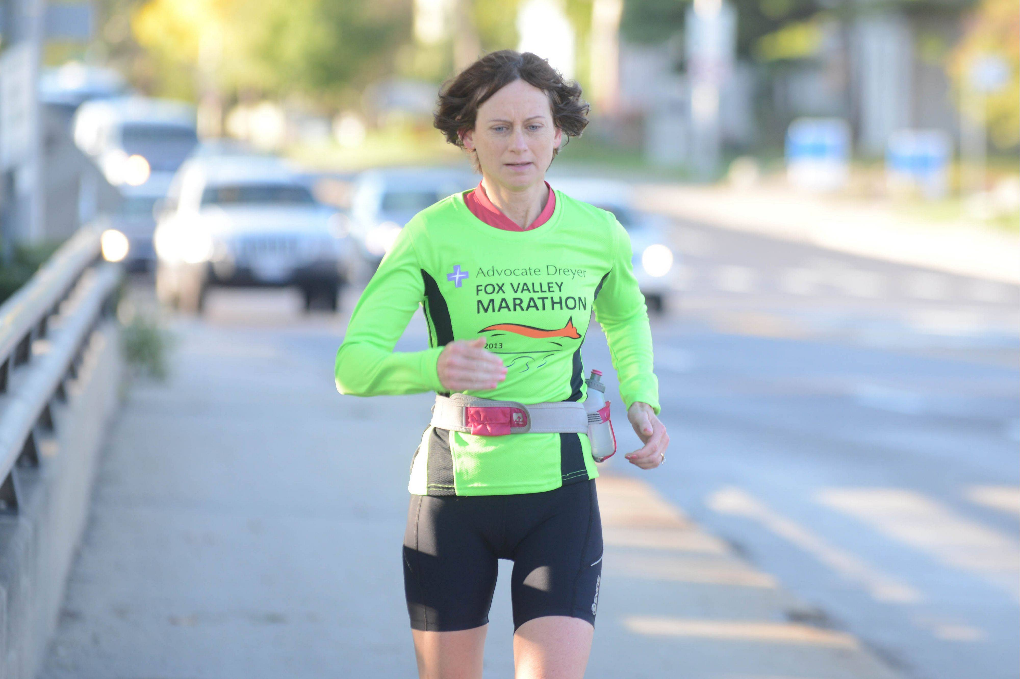 Kim Castner of Naperville nears the end of a Saturday morning training run with Naperville Running Company as she prepares for the inaugural Naperville Marathon.