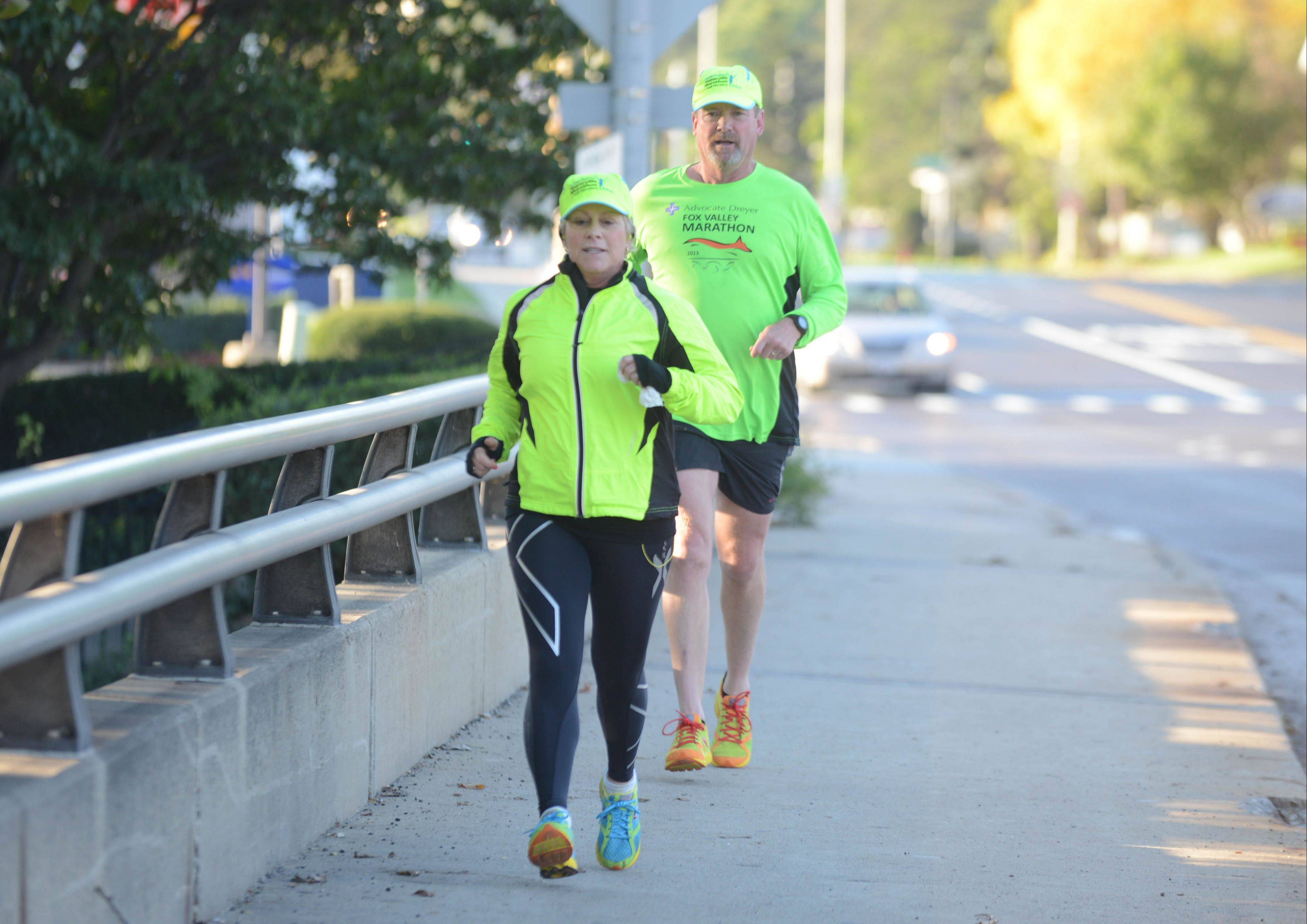 Polly and Bob Hackett of St. Charles complete a training run for the Naperville Marathon with Naperville Running Company. Bob Hackett is one of the directors of the race.