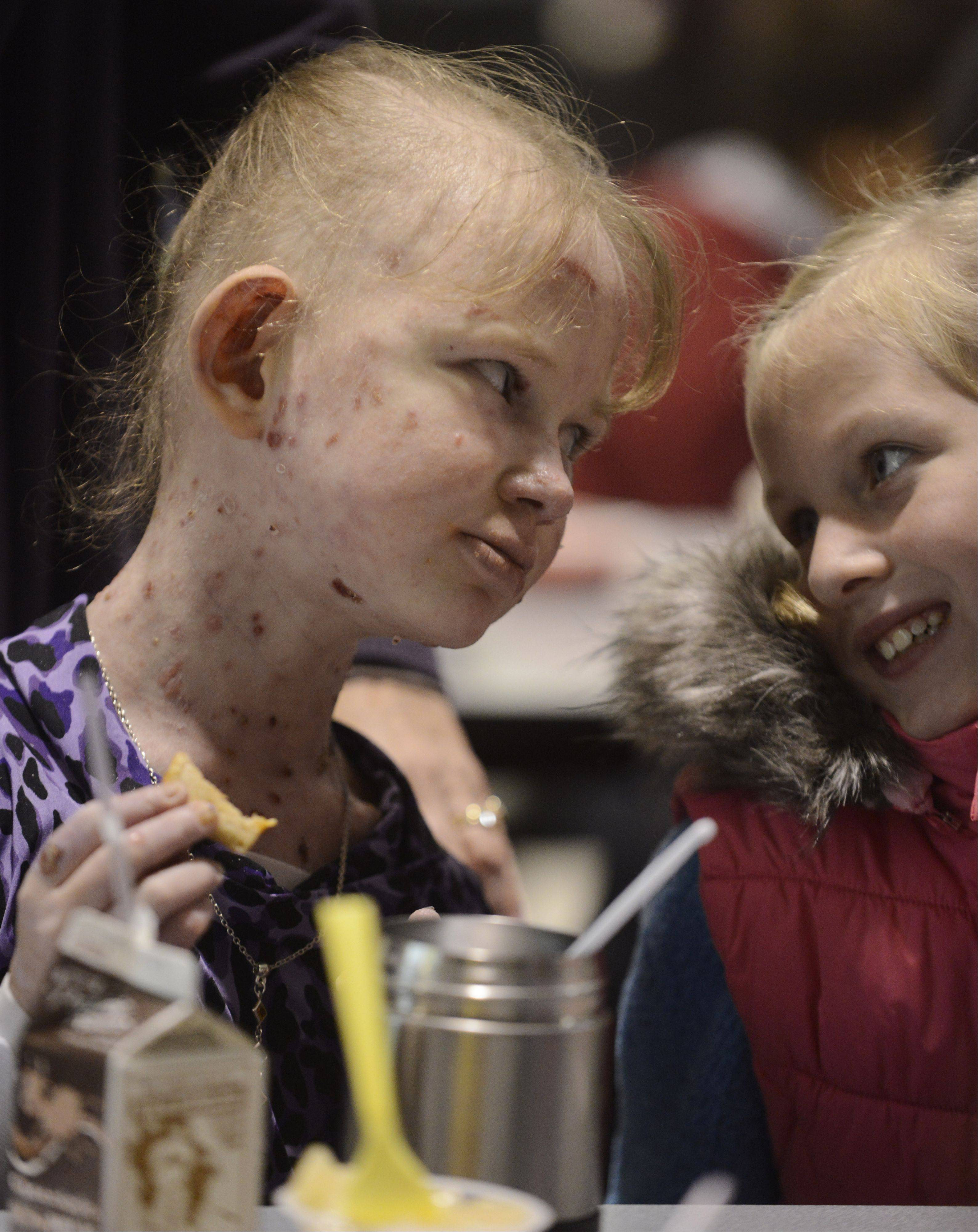 Talking as only good friends can do, Caroline Provost, left, has lunch with friend Cece Gray at Kimball Hill School in Rolling Meadows.