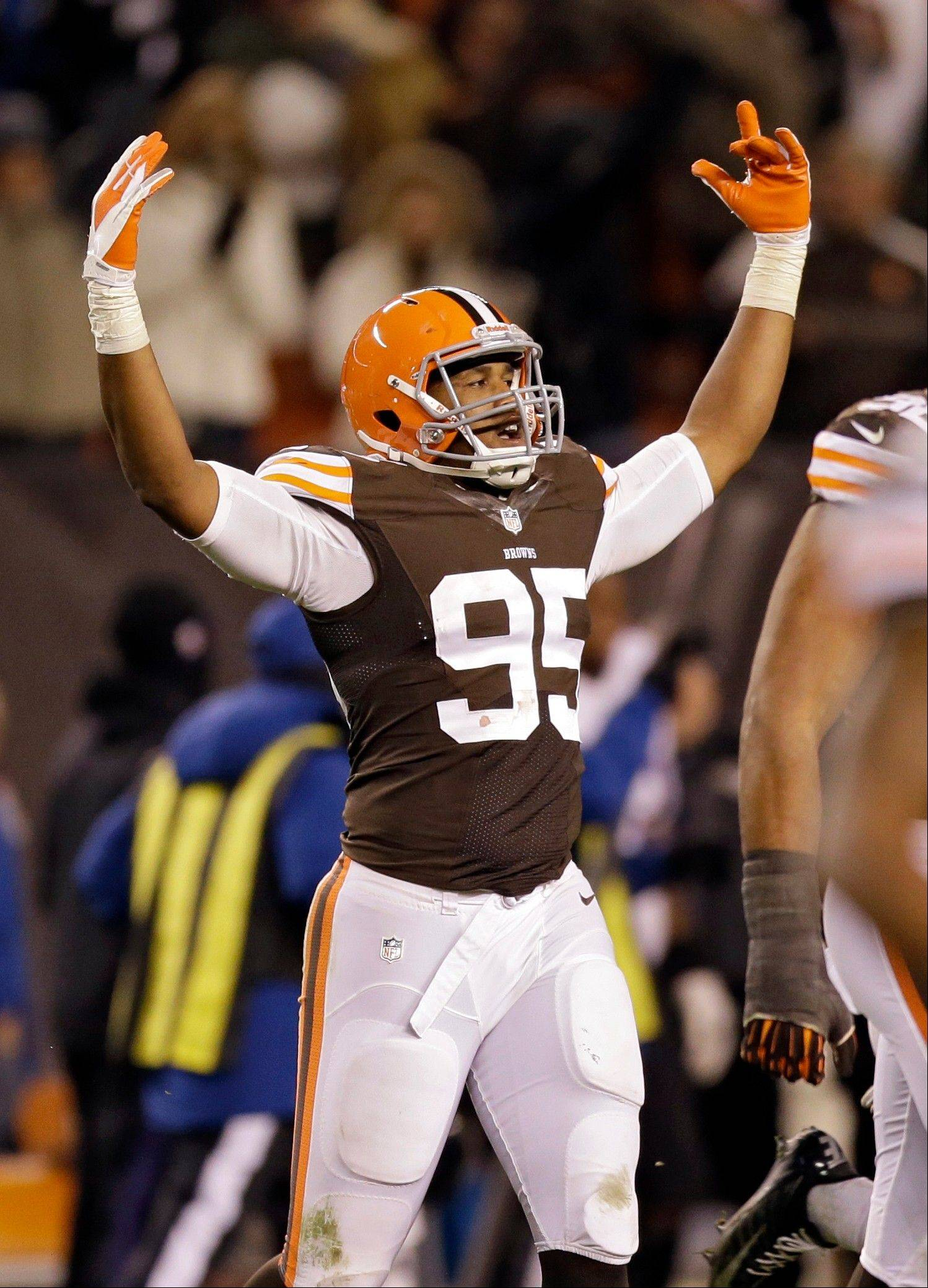 Cleveland Browns defensive end Armonty Bryant celebrates after a 24-18 win over the Baltimore Ravens in an NFL football game Sunday, Nov. 3, 2013, in Cleveland.
