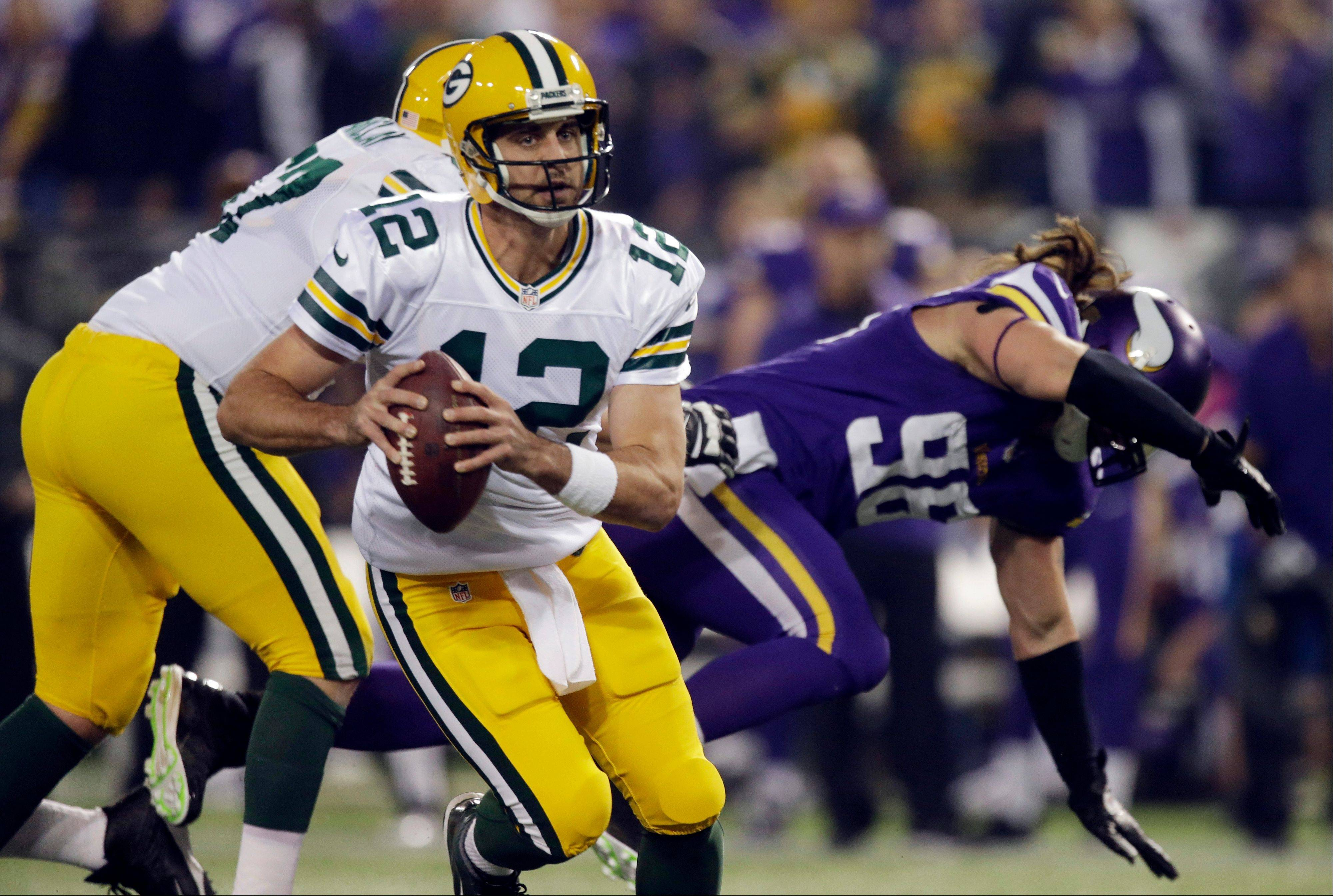 Green Bay Packers quarterback Aaron Rodgers (12) runs in the first half of an NFL football game against the Minnesota Vikings, Sunday, Oct. 27, 2013, in Minneapolis.