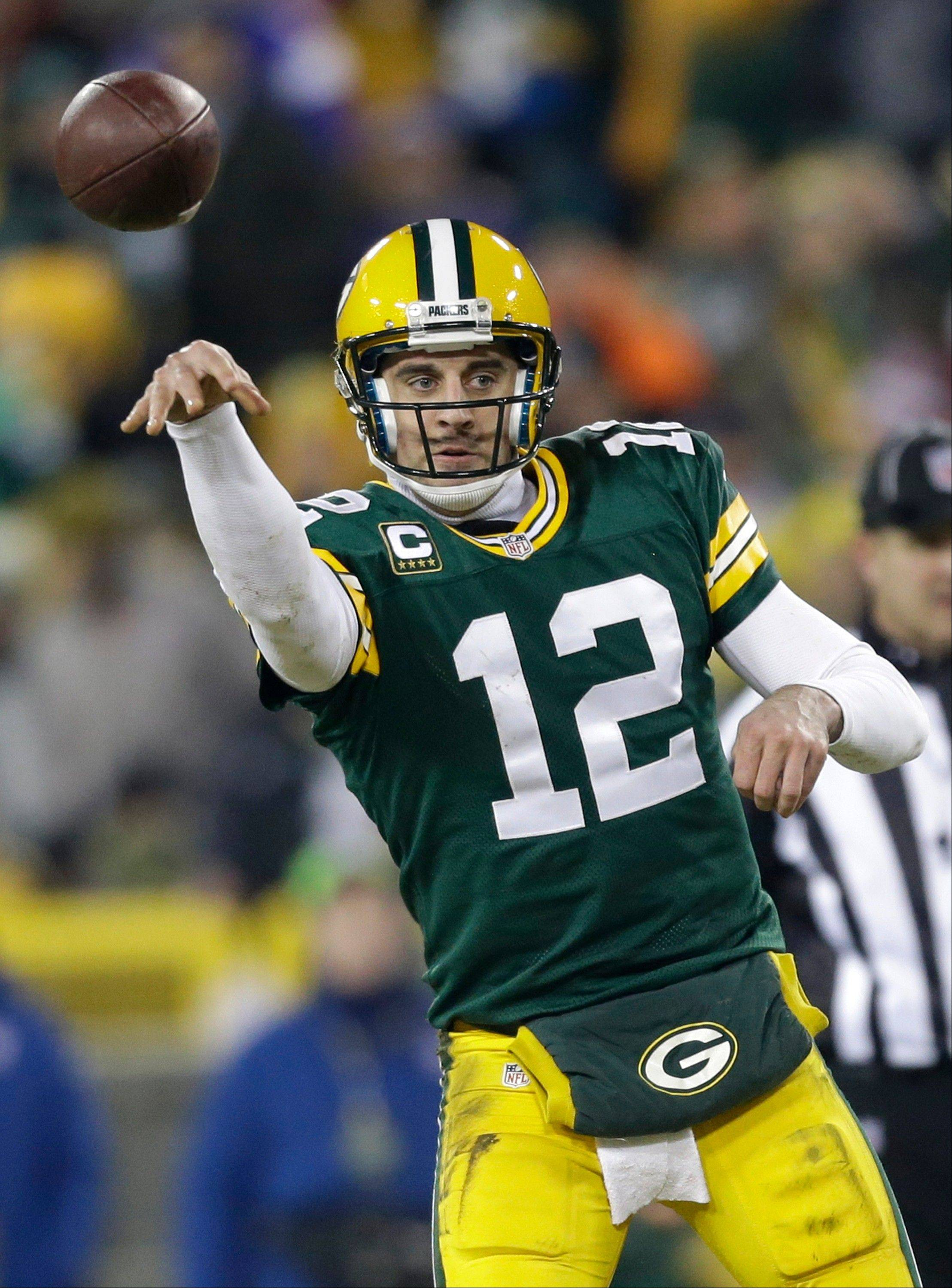 Green Bay Packers quarterback Aaron Rodgers throws a pass during the second half of an NFL wild card playoff football game against the Minnesota Vikings Saturday, Jan. 5, 2013, in Green Bay, Wis.