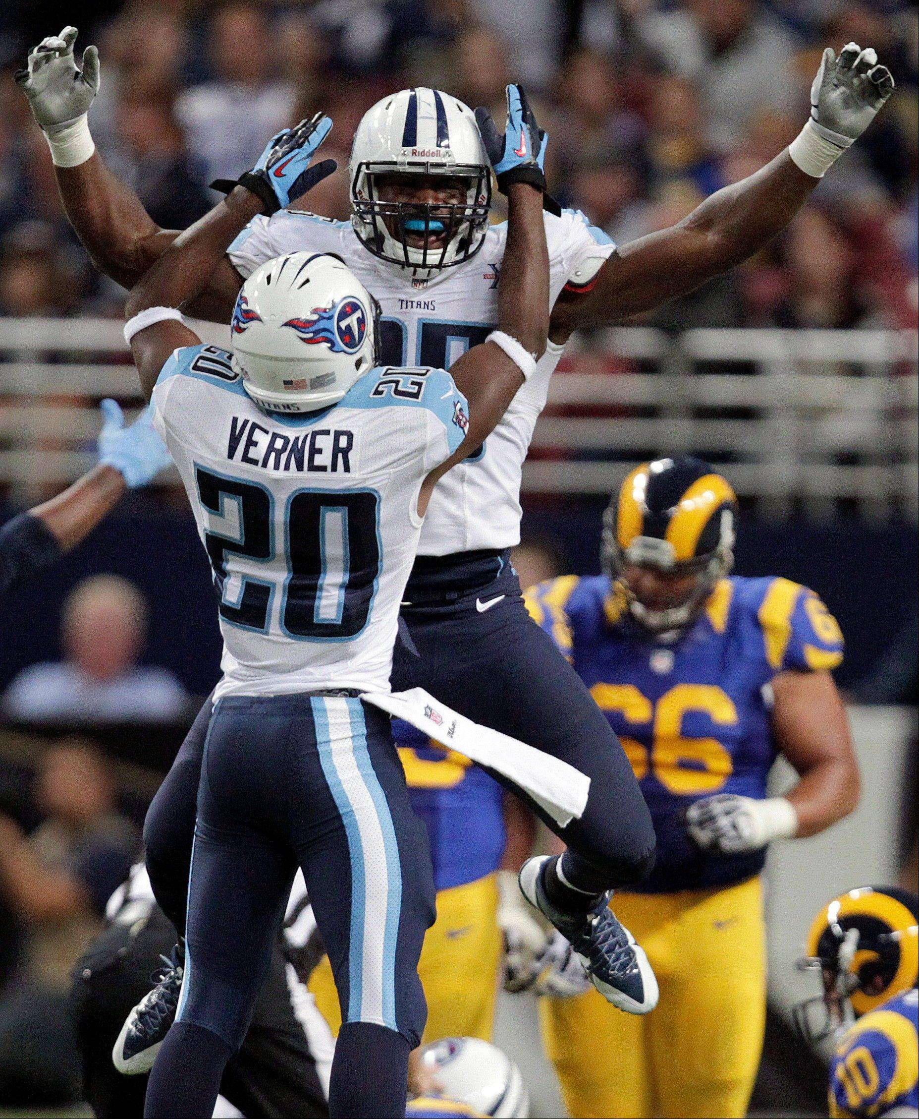Tennessee Titans defensive end Kamerion Wimbley and teammate Alterraun Verner celebrate after a fumble by St. Louis Rams quarterback Kellen Clemens during the fourth quarter of an NFL football game Sunday, Nov. 3, 2013, in St. Louis.